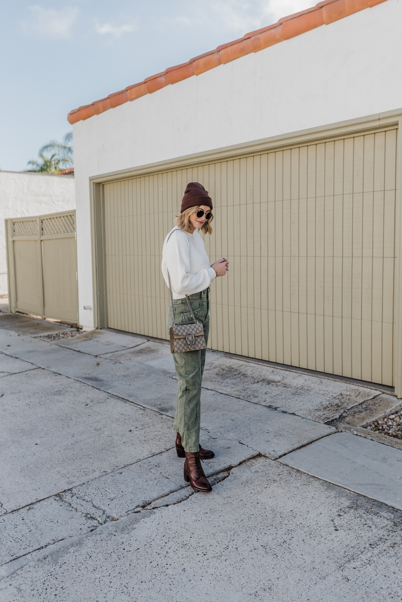 Winter Accessories - Navy Grace - Camilla Thurman - Lady in Green Pants and Brown Beanie