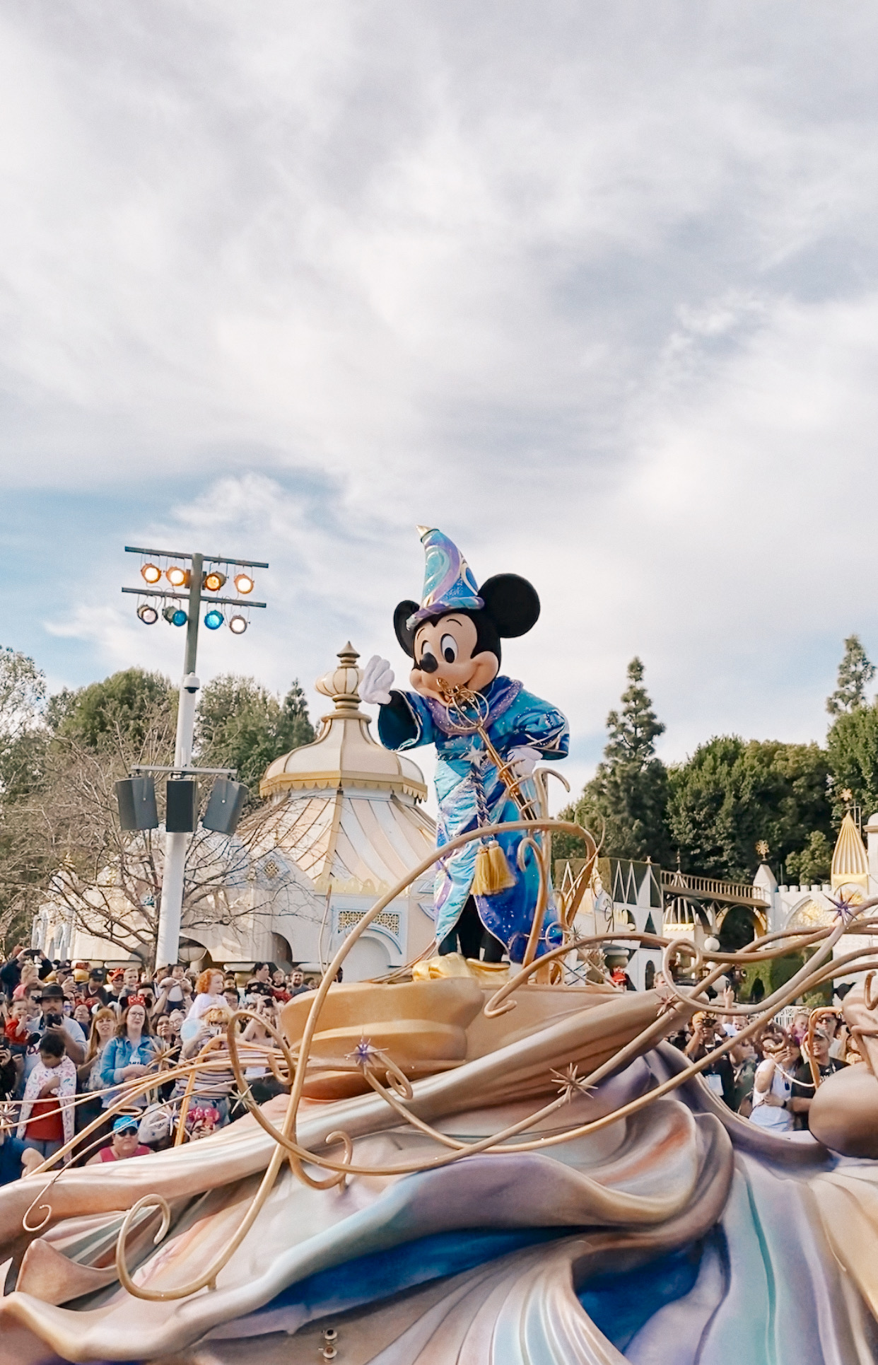TOP 10 BEST DISNEYLAND TIPS FOR YOUR FAMILY featured by top San Diego blog, Navy Grace | Disneyland Tips by popular San Diego lifestyle blog, Navy Grace: image of Mickey Mouse on a float in a Disneyland parade.