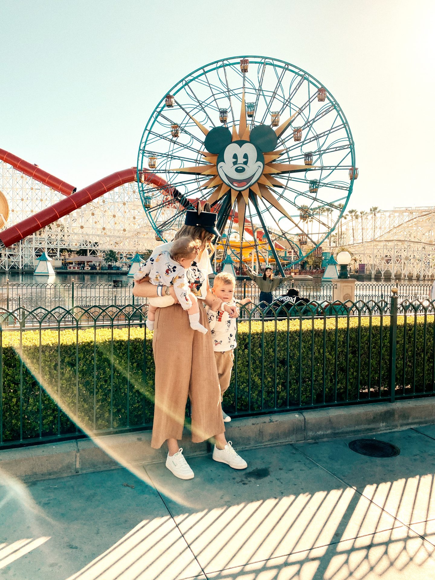 TOP 10 BEST DISNEYLAND TIPS FOR YOUR FAMILY featured by top San Diego blog, Navy Grace | Disneyland Tips by popular San Diego lifestyle blog, Navy Grace: image of a mom and her two kids standing in front of the ferris wheel at California Adventure.