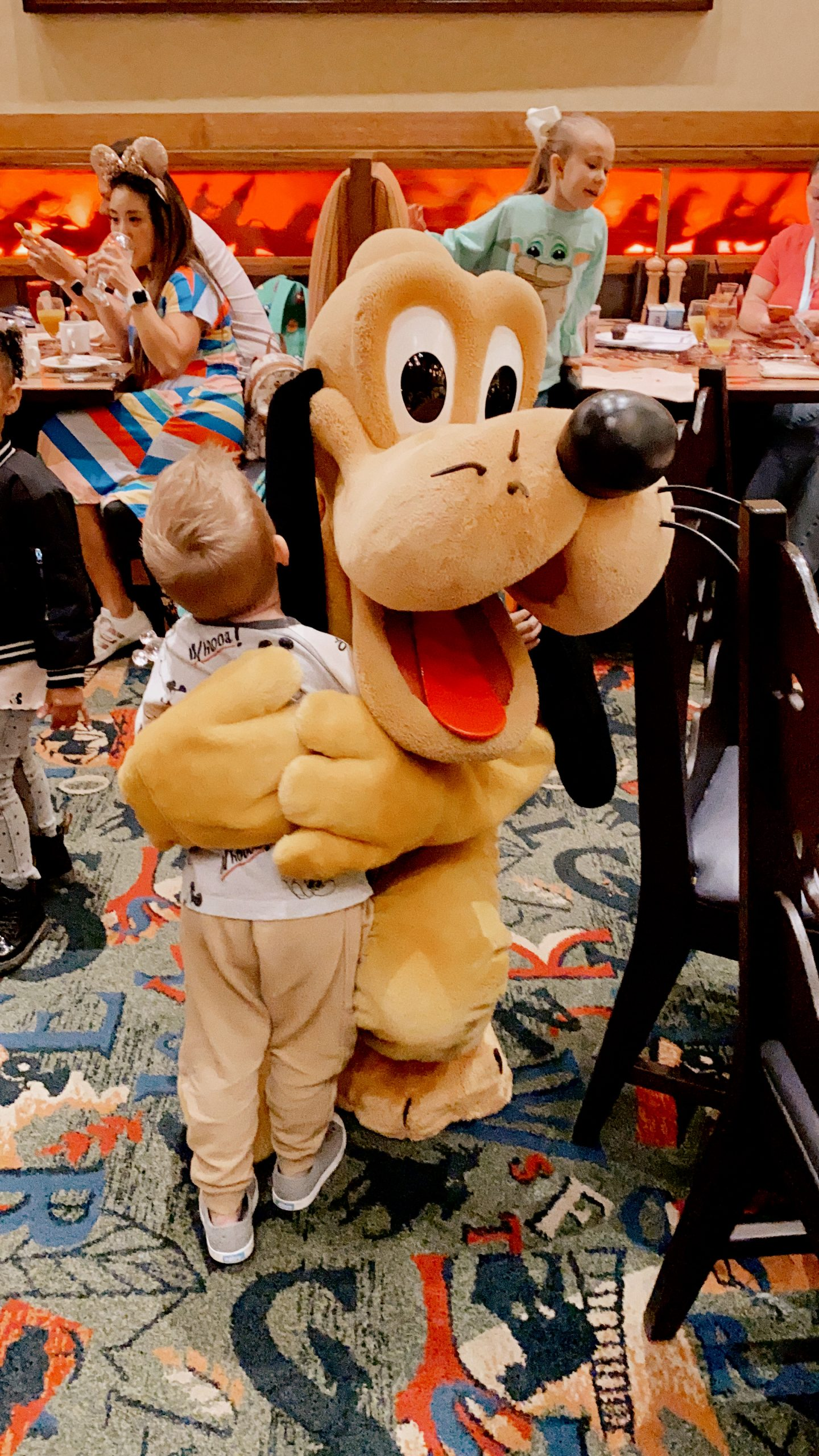 TOP 10 BEST DISNEYLAND TIPS FOR YOUR FAMILY featured by top San Diego blog, Navy Grace | Disneyland Tips by popular San Diego lifestyle blog, Navy Grace: image of little boy hugging Pluto at Disneyland.