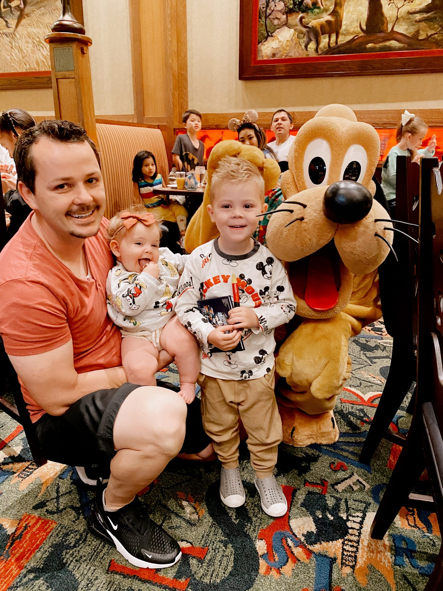 TOP 10 BEST DISNEYLAND TIPS FOR YOUR FAMILY featured by top San Diego blog, Navy Grace | Disneyland Tips by popular San Diego lifestyle blog, Navy Grace: image of a dad and his two kids standing next to Pluto at Disneyland.