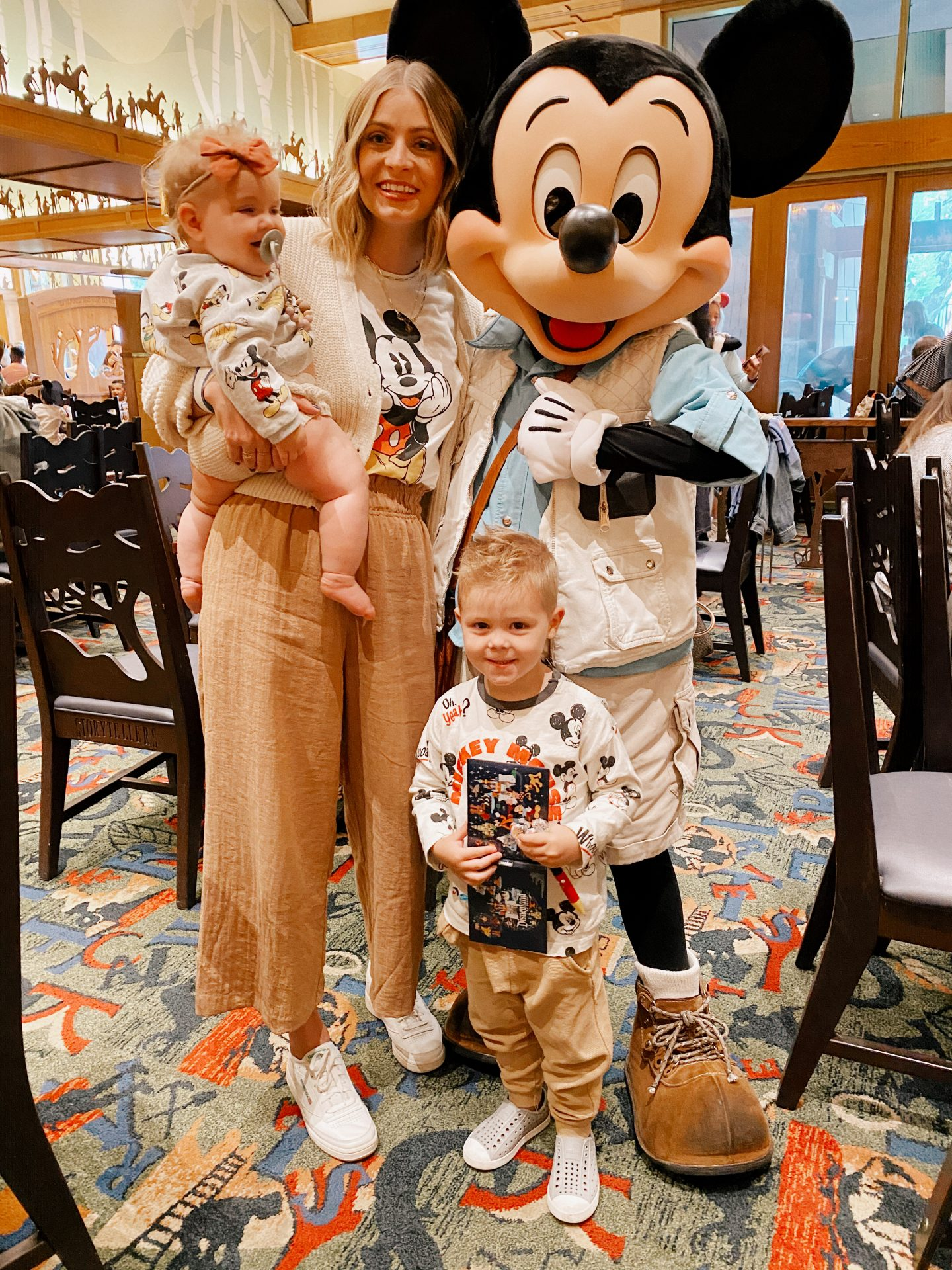 TOP 10 BEST DISNEYLAND TIPS FOR YOUR FAMILY featured by top San Diego blog, Navy Grace | Disneyland Tips by popular San Diego lifestyle blog, Navy Grace: image of a mom and her her two kids standing next to Mickey Mouse at Disneyland.
