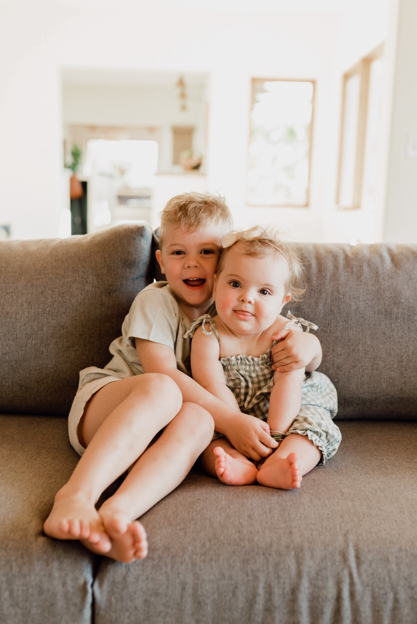 BLOGGING TIPS: 5 THINGS TO DO WHEN YOUR WORDPRESS WEBSITE GETS HACKED featured by top US life and style San Diego blog, Navy Grace | WordPress Hacking by popular San Diego blog, Navy Grace: image of a little boy and girl cuddling on a grey couch.