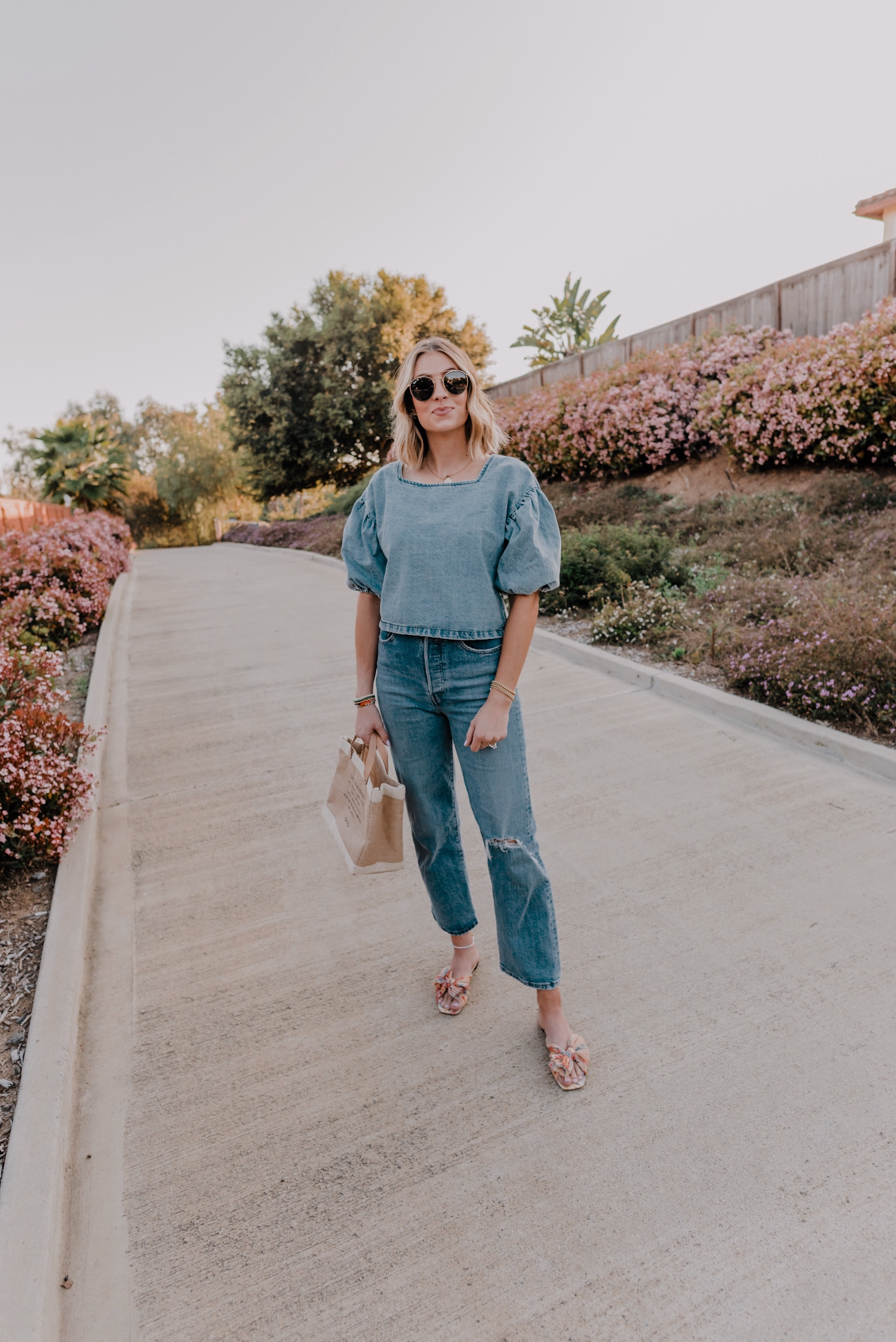 CUTE DENIM TOPS FOR WOMEN featured by top San Francisco fashion blog, Navy Grace: image of a woman wearing The Odells denim top.