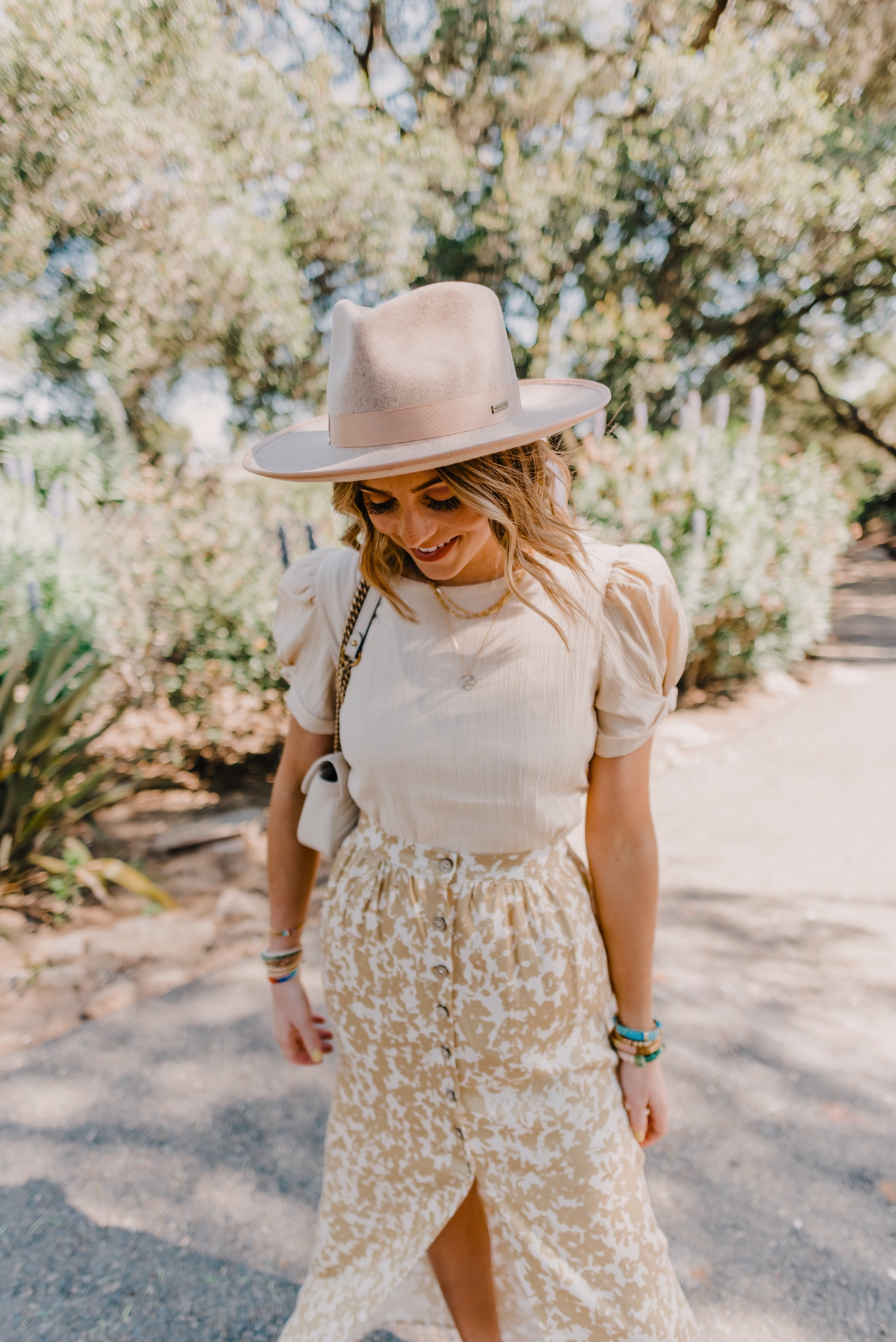 SPRINGTIME PUFF SLEEVE TOPS AND DRESSES for Spring featured by top San Francisco fashion blog, Navy Grace: image of a woman wearing a Moon River puff sleeve top.