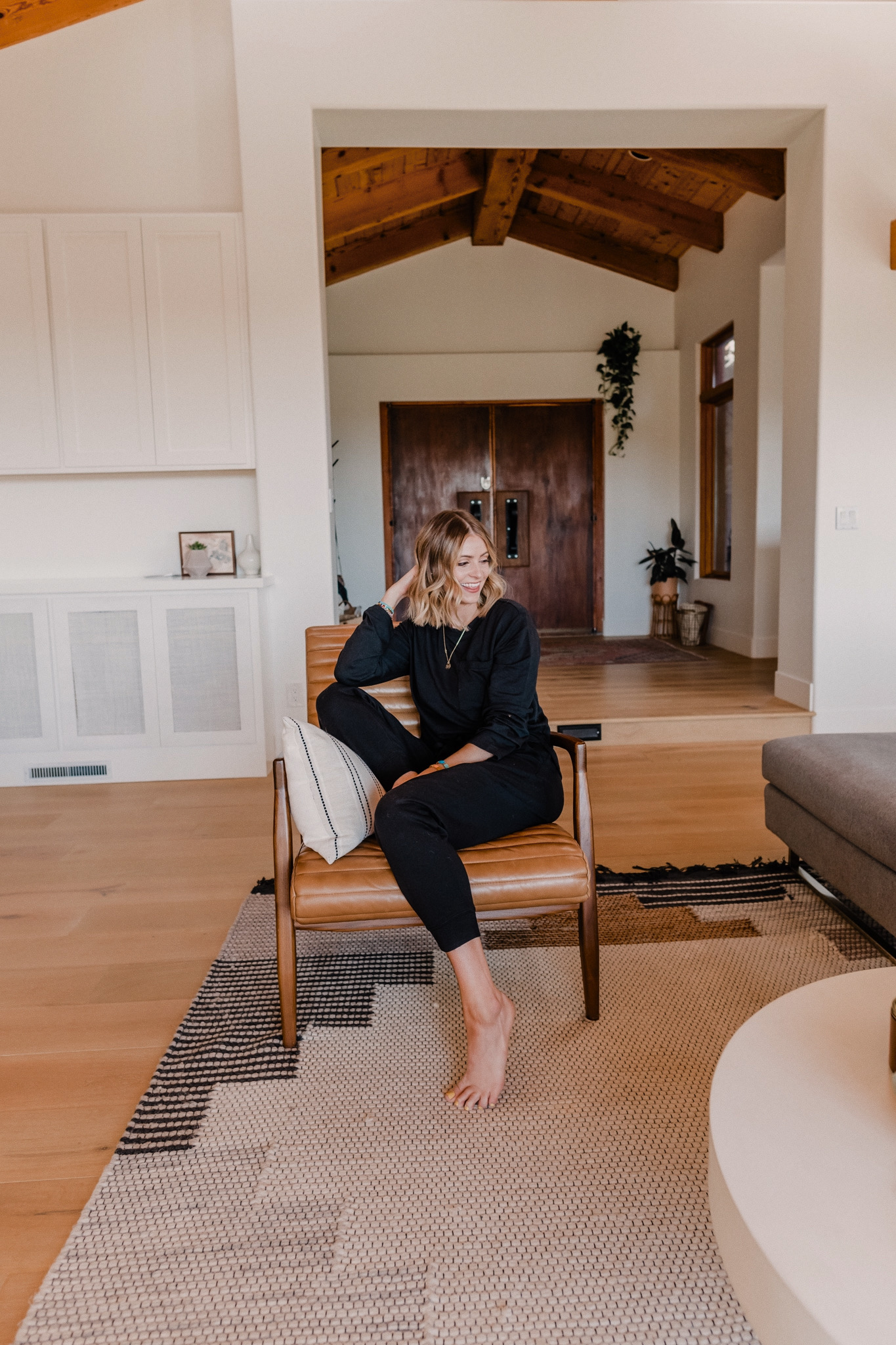BEST COMFY LOUNGEWEAR FOR MOMS featured by top San Francisco fashion blog, Navy Grace: image of a woman wearing an Amazon black top and jogger pants.
