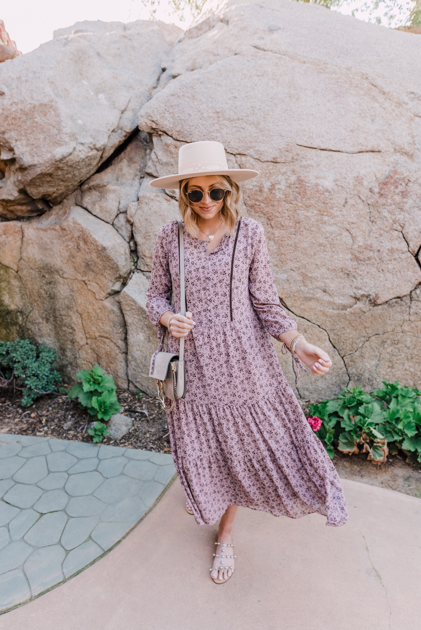 March Best Sellers by popular San Diego fashion blog, Navy Grace: image of a woman wearing a Free People Sierra Boater Hat, ShopBop Madewell Tiered Midi Dress, Nordstrom Icons 50mm Round Metal Sunglasses RAY-BAN, studded slide sandals, and Nordstrom Small Matelassé Leather Shoulder Bag GUCCI