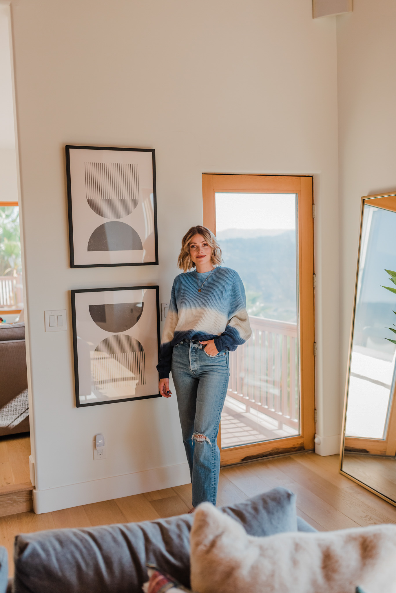 Minted Art by popular life and style blog, Navy Grace: image of a woman standing next to two framed Etsy Mid century style woodblock print in classic geometric shapes and neutral colors.