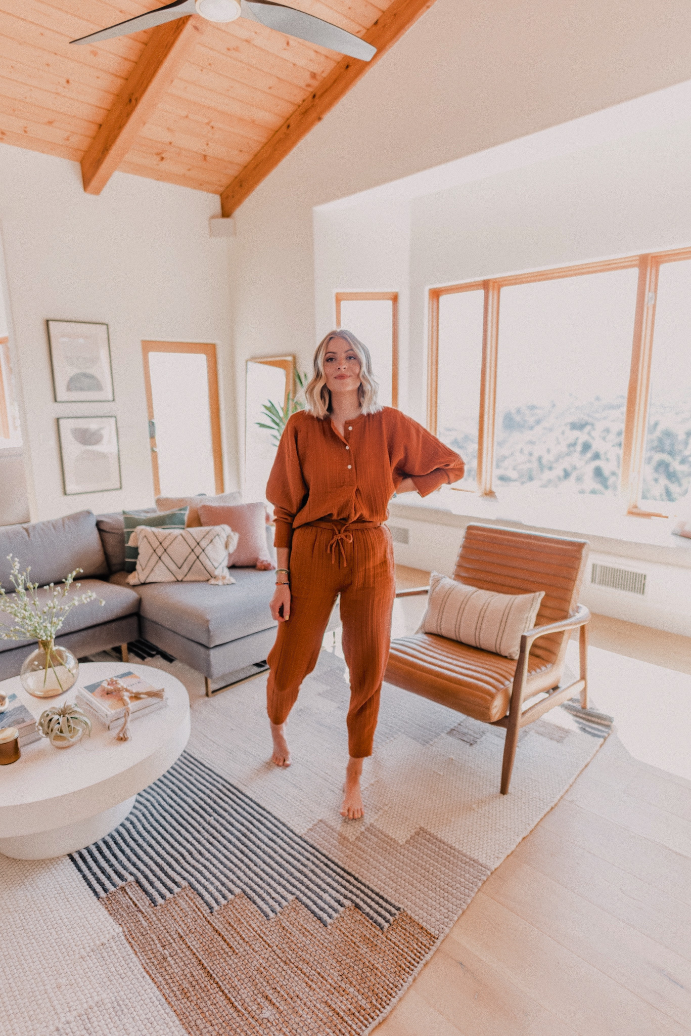 Favorite Things on Amazon by popular San Diego life and style blog, Navy Grace: image of a woman standing in her living room and wearing a Lou & Grey Triple Cloth Henley Tunic Shirt, Lou & Grey Triple Cloth Joggers, and Gorjana Parker Wrap Necklace.
