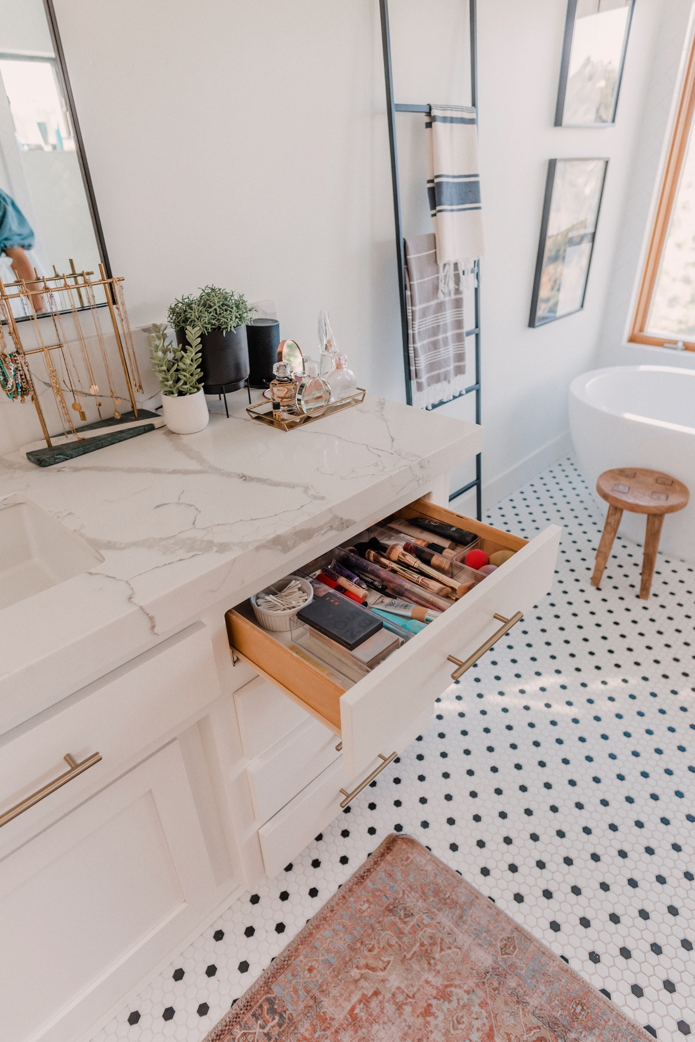 Kitchen Organization Products by popular San Diego life and style blog, Navy Grace: image of a organized makeup drawer in a bathroom vanity.