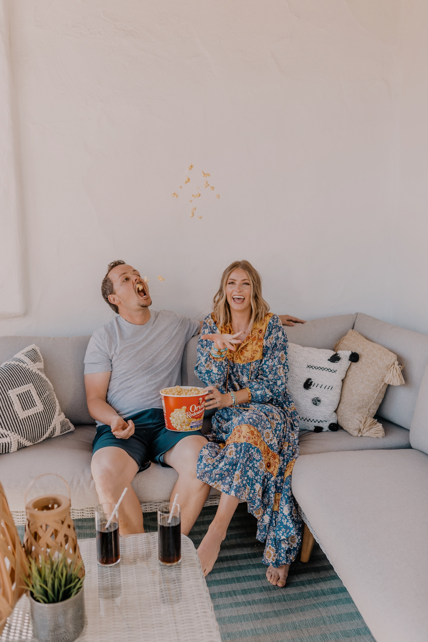 Orville Redenbacher's Popcorn by popular San Diego lifestyle blog, Navy Grace: image of a husband and wife sitting on their patio and eating some Orville Redenbacher's popcorn.