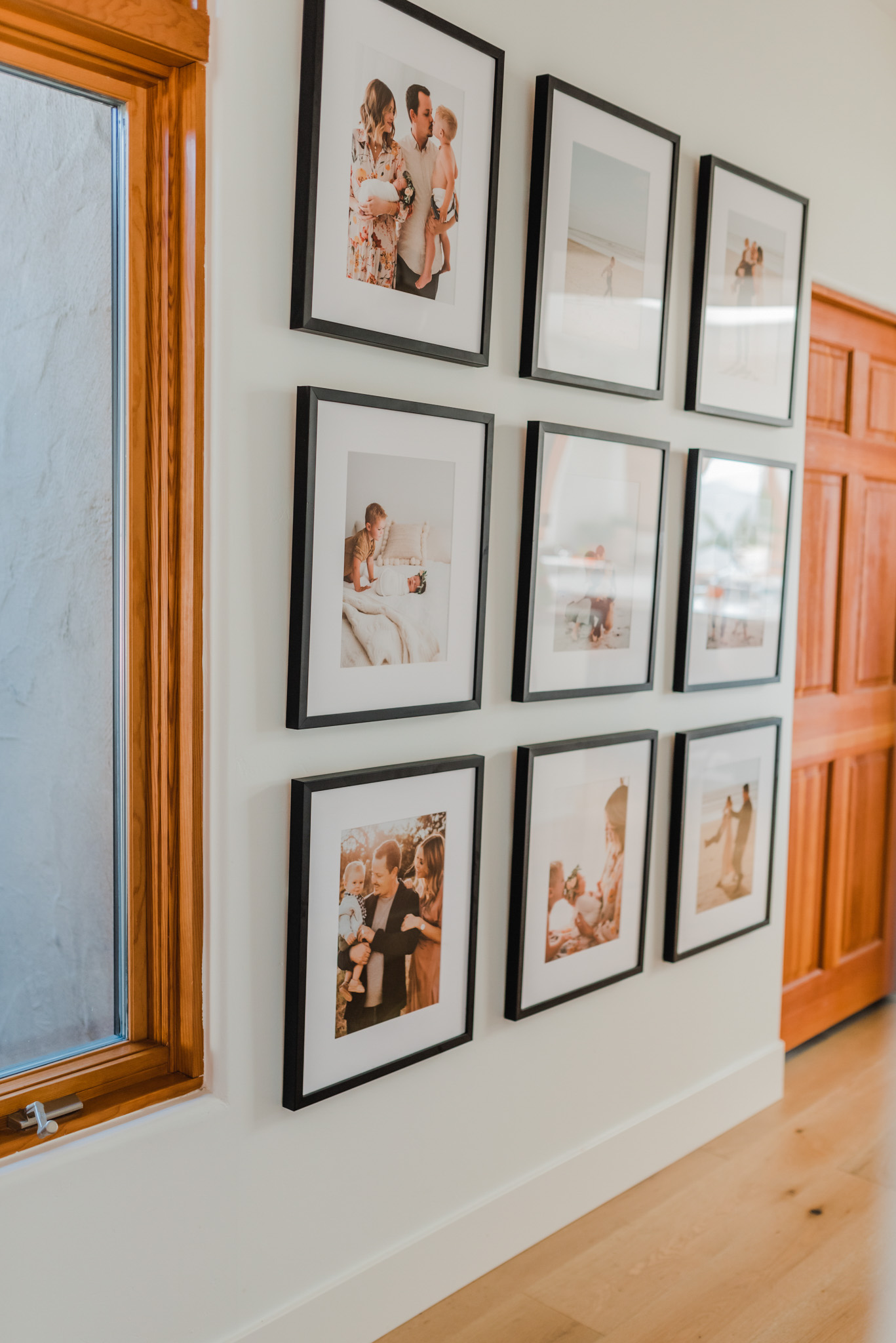 Frambridge Frames by popular San Diego life and style blog, Navy Grace: image of a wall in a home with multiple Framebridge frames hanging on it.