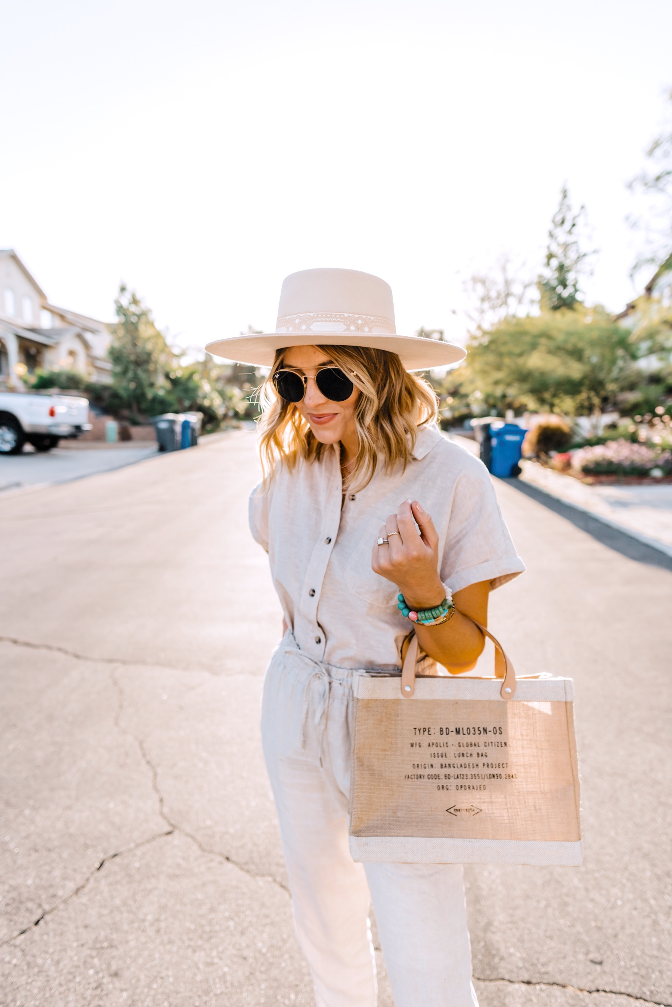 Linen Blend by popular San Diego fashion blog, Navy Grace: image of a woman standing outside and wearing H&M Linen Joggers, H&M Linen-blend Shirt, H&M metallic sandals, Free People Sierra Boater Hat and Ray-Ban ROUND DOUBLE BRIDGE @COLLECTION sunglasses.
