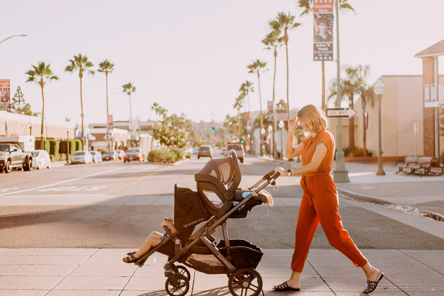 Nordstrom Anniversary Sale by popular San Diego fashion blog, Navy Grace: image of a woman pushing her two children in a double stroller across the street.