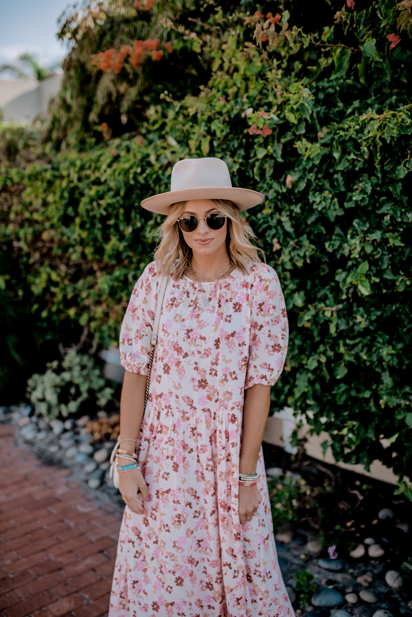 Gold Jewelry by popular San Diego fashion blog, Navy Grace: image of a woman standing outside and wearing a H&M Calf-length Dress, Gigi Pip MONROE RANCHER, Anthropologie Seychelles Tube Slide Sandals, Nordstrom Small Matelassé Leather Shoulder Bag GUCCI, and Nordstrom Icons 50mm Round Metal Sunglasses RAY-BAN.