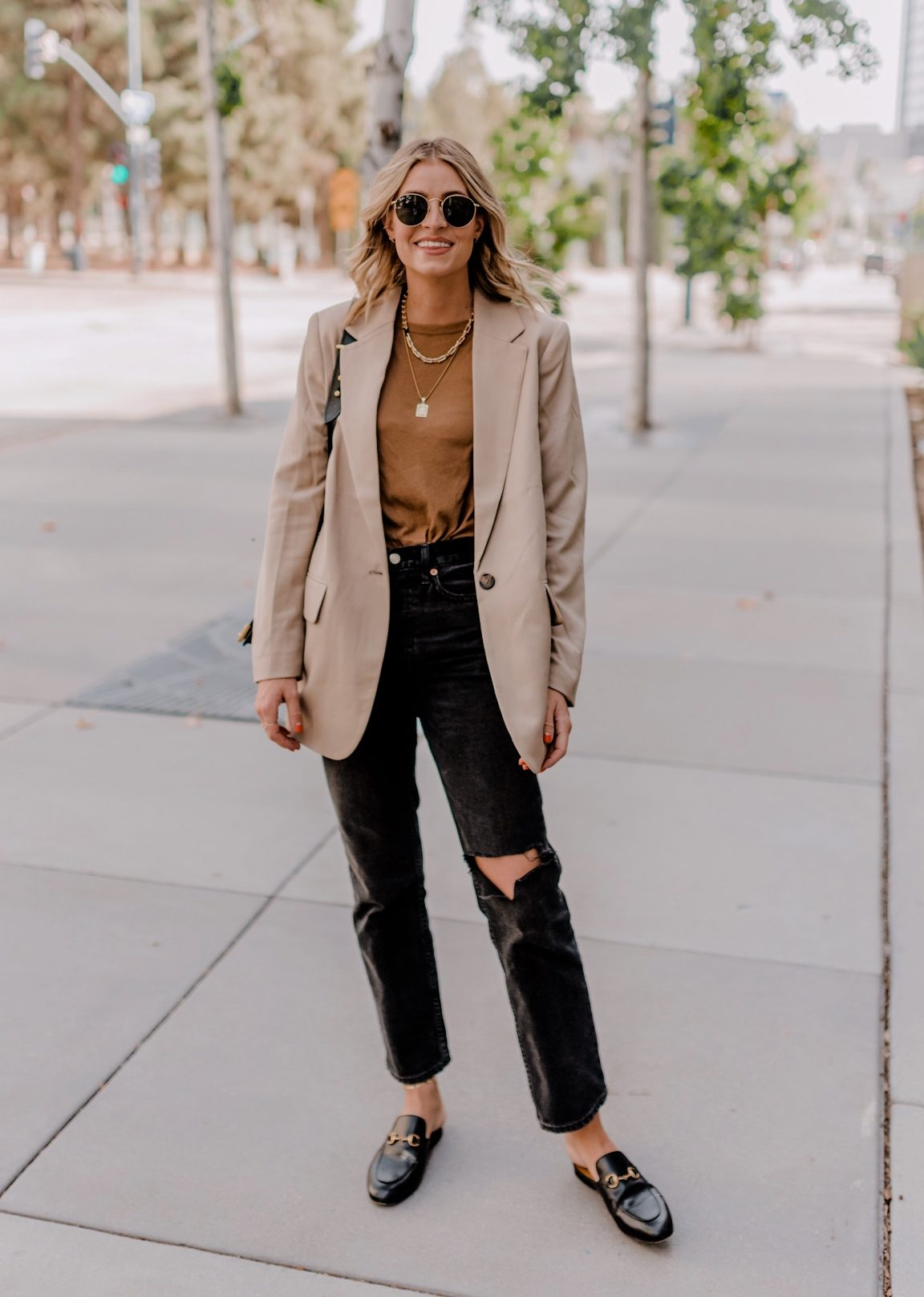 HIGH AND LOW FASHION favorites for Fall featured by top San Diego fashion blogger, Navy Grace. | Fashion Tips by popular San Diego fashion blog, Navy Grace: image a a woman standing outside and wearing a Nordstrom Single Breasted Girlfriend Blazer TOPSHOP, Nordstrom Chicago Ripped Knee High Waist Dad Jeans TOPSHOP, Everlane The Air Oversized Crew Tee, Nordstrom Princetown Loafer Mule, and Nordstrom Icons 50mm Round Metal Sunglasses RAY-BAN.