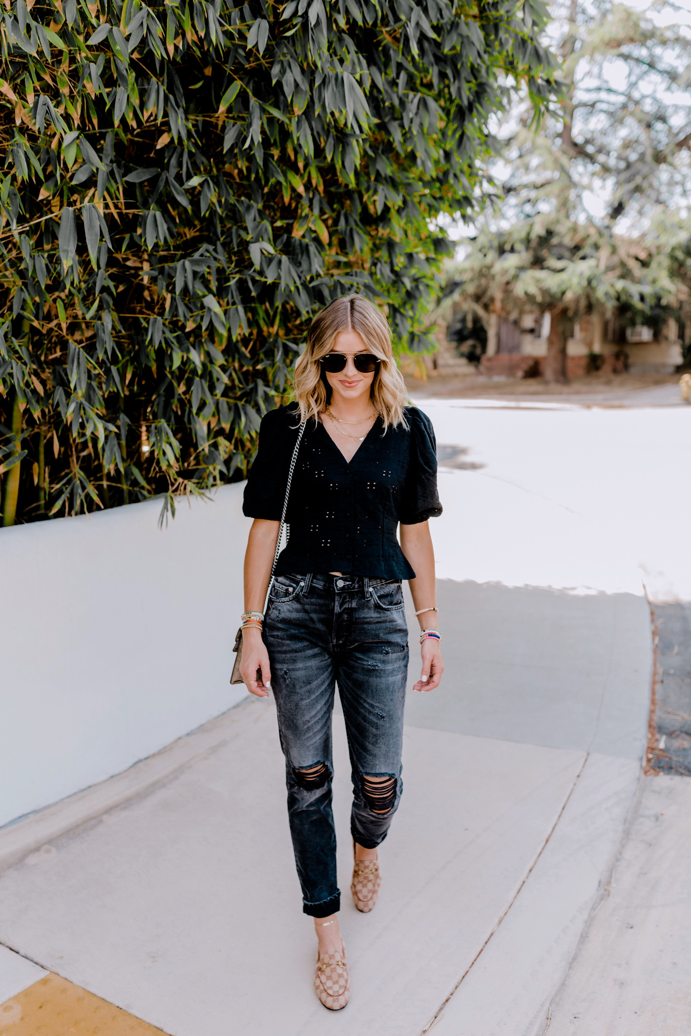 Fall Wardrobe by popular San Diego fashion blog, Navy Grace: image of a woman walking outside and wearing a H&M Puff-sleeved V-neck Top, Nordstrom Blaze General 58mm Aviator Sunglasses RAY-BAN, Gucci Dionysus GG Supreme mini bag, and Gucci Women's Jordaan GG Canvas Loafers.
