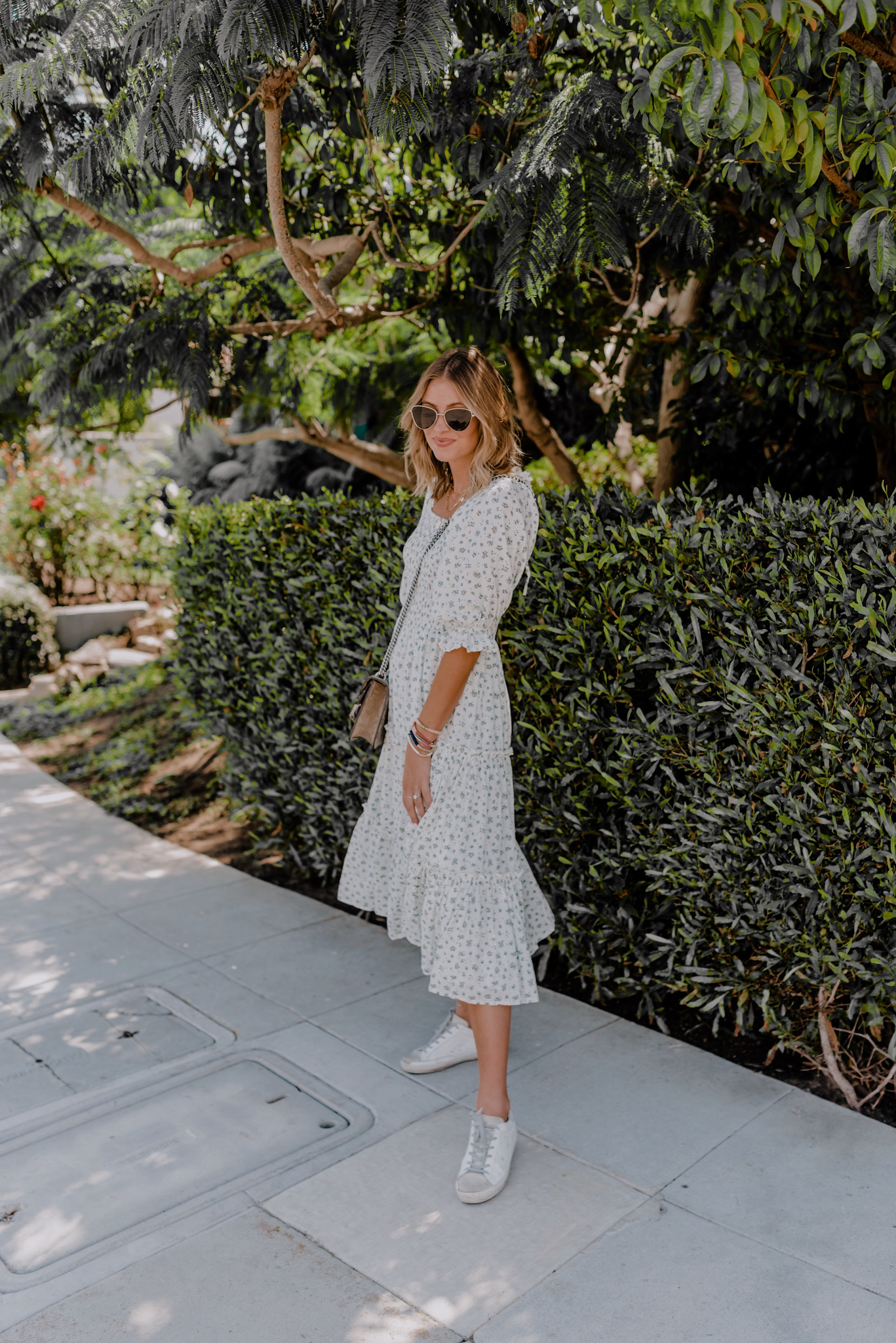 Amazon Favorites by popular San Diego life and style blog, Navy Grace: image of a woman standing outside and wearing a Ivy City Co. Madeline Dress, Golden Goose Superstar Sneakers, Le Specs Echo Sunglasses, and carrying a Gucci Dionysus GG Supreme mini bag.
