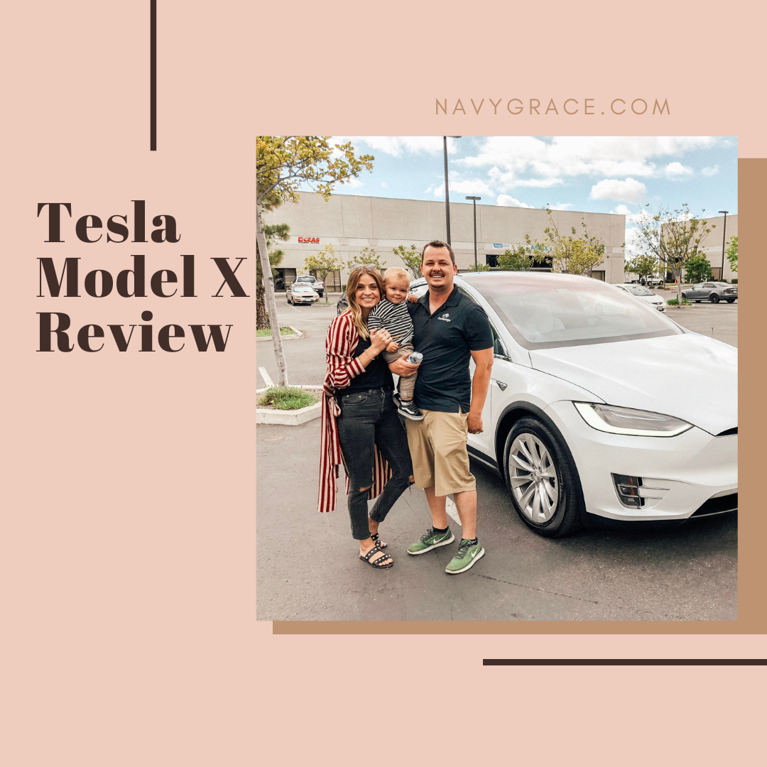 Popular Topics by San Diego lifestyle blog, Navy Grace: Pinterest image of a husband and wife and their baby son standing in front of a Tesla Model X.