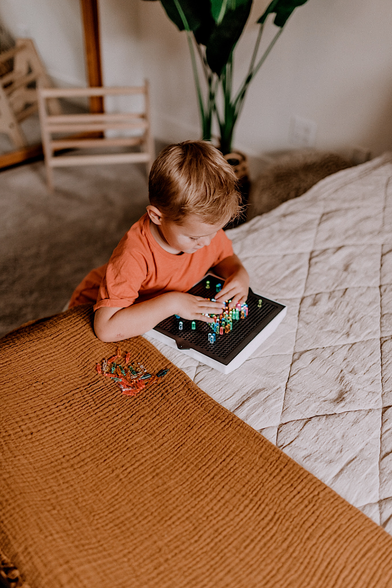 15 LEARNING ACTIVITIES FOR 3 TO 5 YEAR OLDS to try featured by top San Diego lifestyle blogger, Navy Grace |Learning Activities by popular San Diego motherhood blog, Navy Grace: image of a boy playing with a Lite Brite.