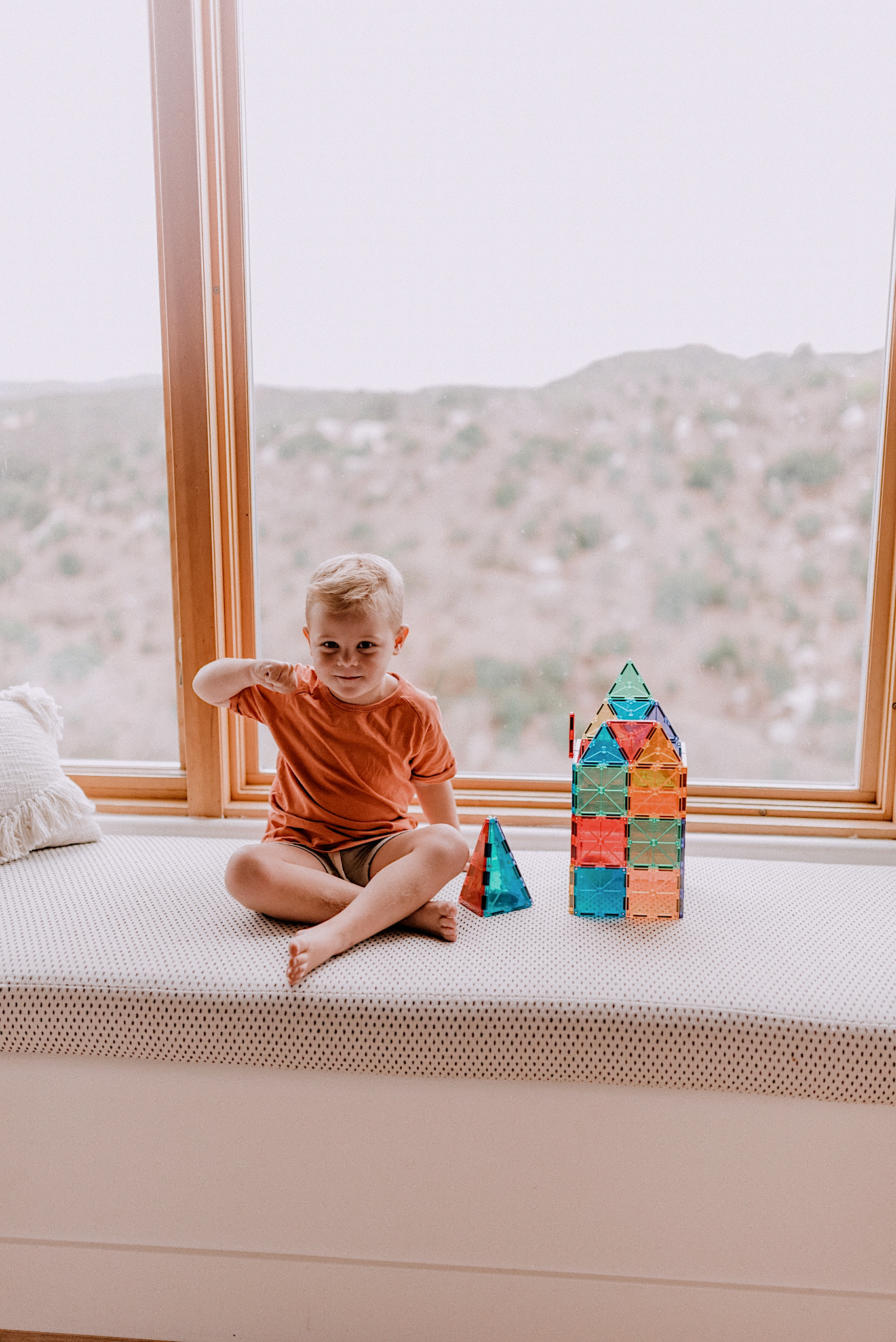 15 LEARNING ACTIVITIES FOR 3 TO 5 YEAR OLDS to try featured by top San Diego lifestyle blogger, Navy Grace |Learning Activities by popular San Diego motherhood blog, Navy Grace: image of a boy playing with magna tiles.