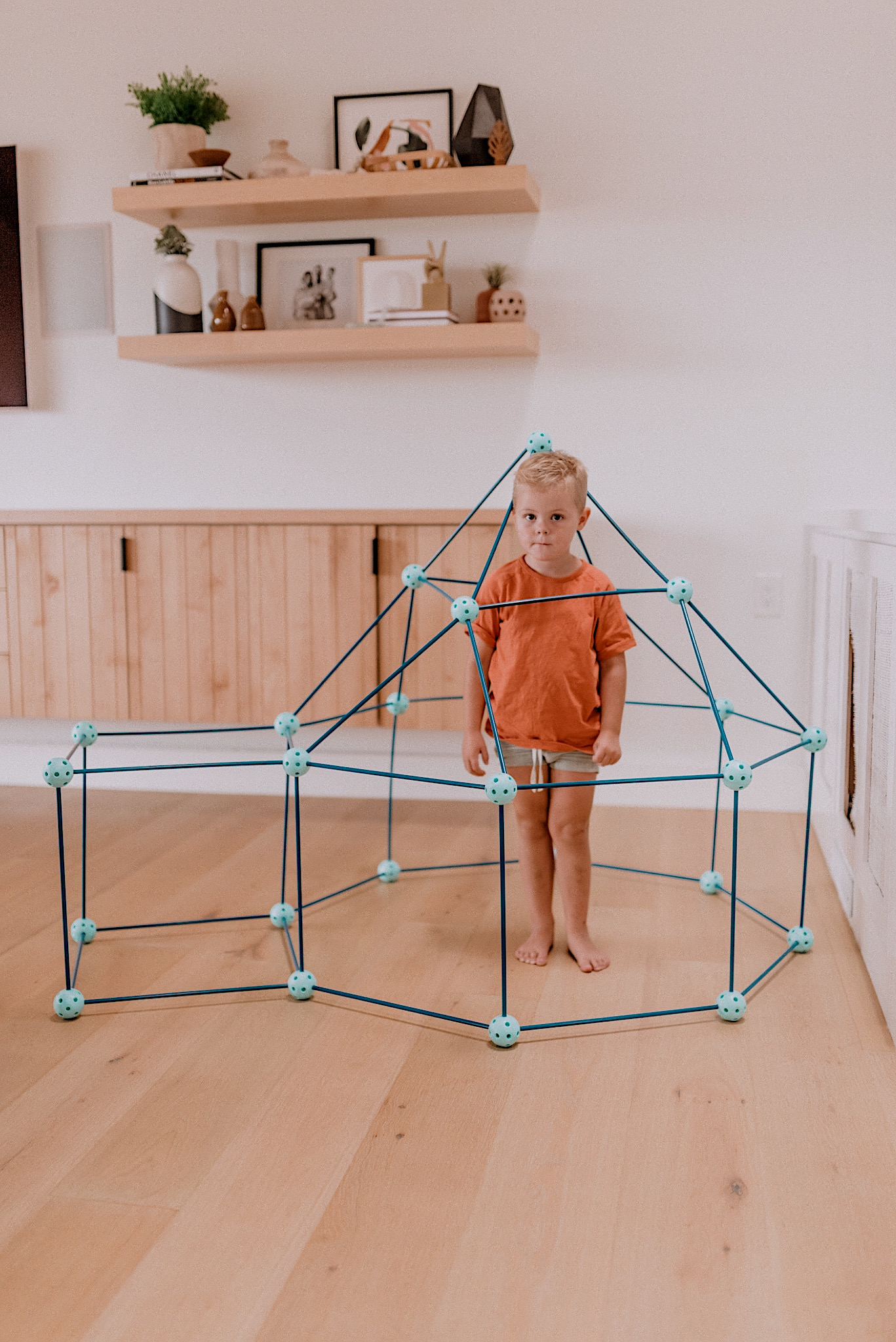 15 LEARNING ACTIVITIES FOR 3 TO 5 YEAR OLDS to try featured by top San Diego lifestyle blogger, Navy Grace |Learning Activities by popular San Diego motherhood blog, Navy Grace: image of a boy playing with a Fort Builder Set.