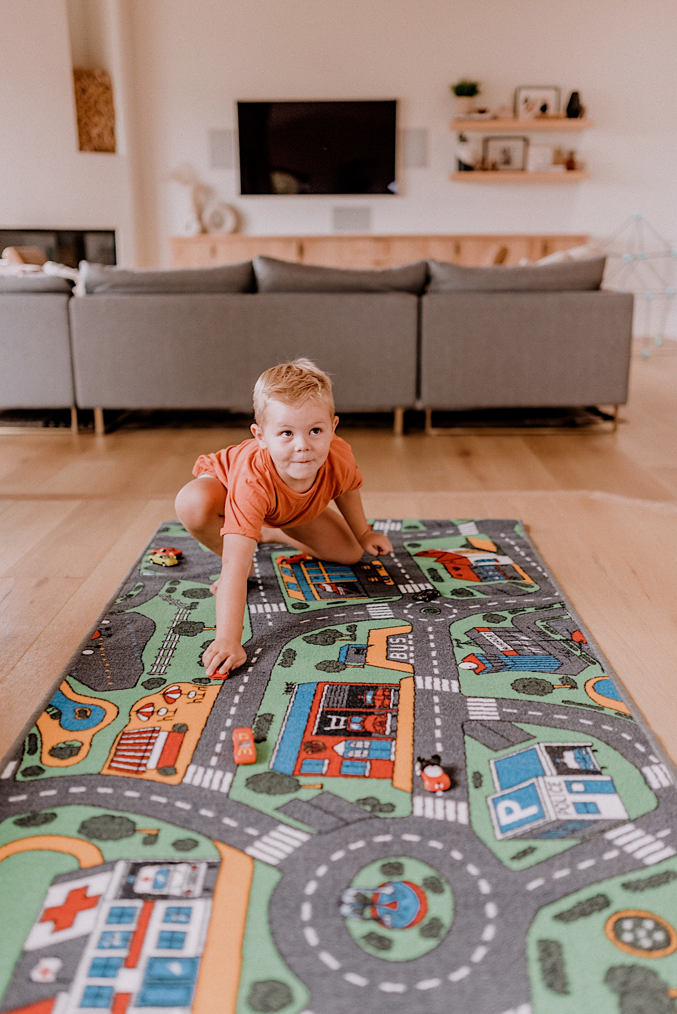 15 LEARNING ACTIVITIES FOR 3 TO 5 YEAR OLDS to try featured by top San Diego lifestyle blogger, Navy Grace |Learning Activities by popular San Diego motherhood blog, Navy Grace: image of a boy playing on a car mat.