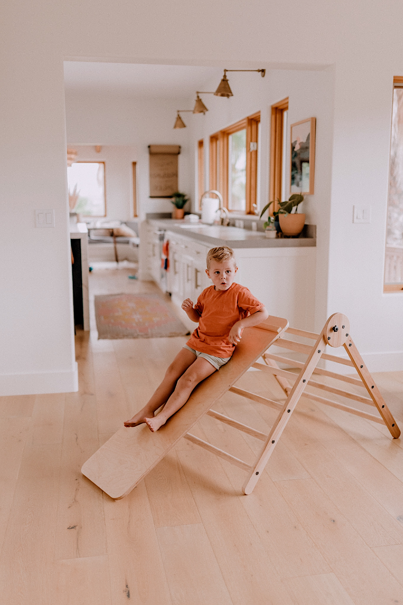 15 LEARNING ACTIVITIES FOR 3 TO 5 YEAR OLDS to try featured by top San Diego lifestyle blogger, Navy Grace |Learning Activities by popular San Diego motherhood blog, Navy Grace: image of a boy playing on a Homi Baby Pikler Triangle Slide and Climbing Set.