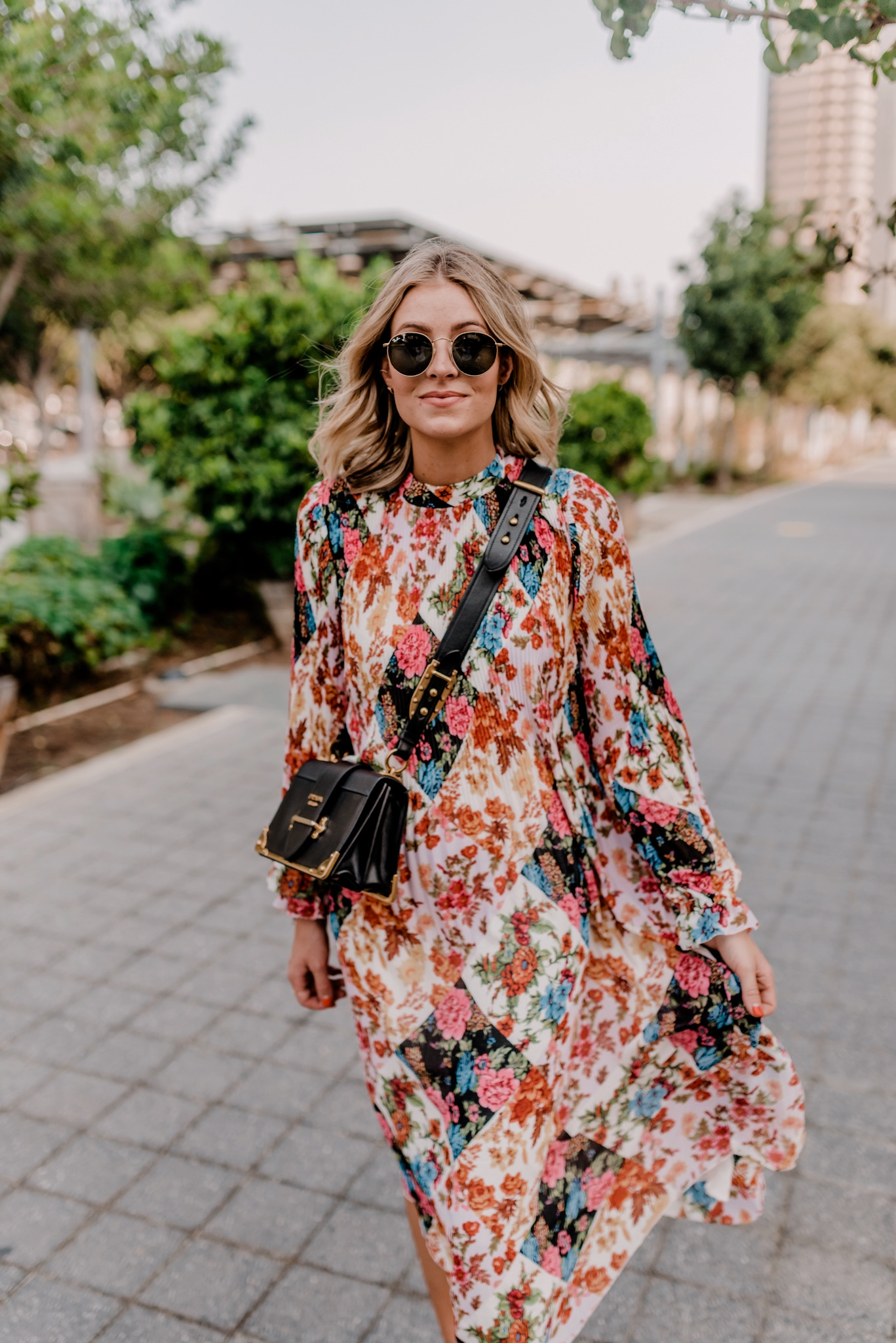Fall Dresses by popular San Diego fashion blog, Nay Grace: image of a woman walking outside and wearing a Anthropologie Shara Pleated Midi Dress, Nordstrom Icons 50mm Round Metal Sunglasses RAY-BAN, and a Prada Cahier shoulder bag.