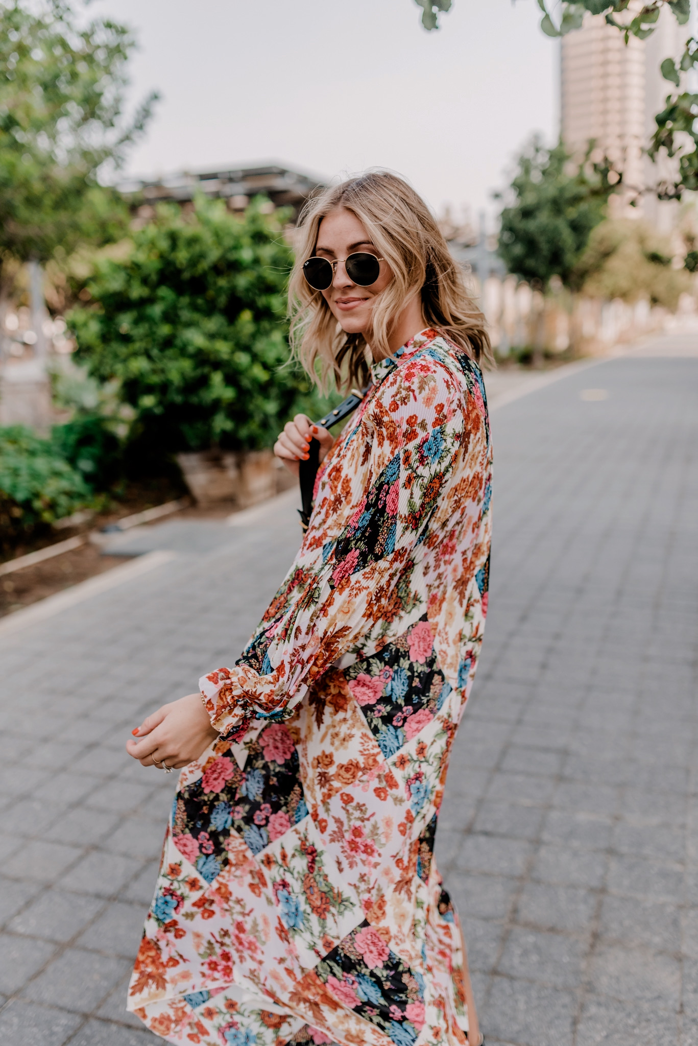 Fall Dresses by popular San Diego fashion blog, Nay Grace: image of a woman walking outside and wearing a Anthropologie Shara Pleated Midi Dress, Nordstrom Icons 50mm Round Metal Sunglasses RAY-BAN, black Converse high top sneakers, and a Prada Cahier shoulder bag.