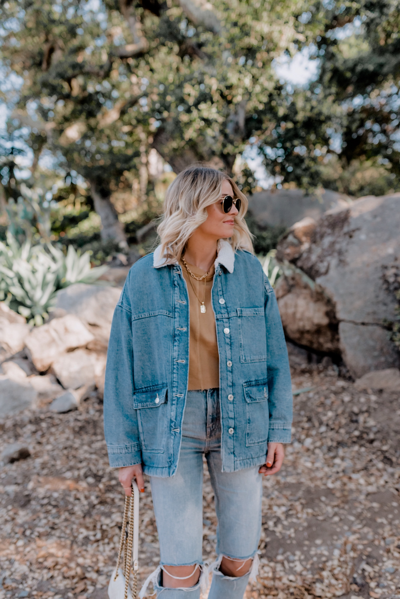 Casual Jackets by popular San Diego fashion blog, Navy Grace: image of a woman wearing a casual oversized denim jacket, Top Shop Double Ripped Mom Jeans,GOLDEN GOOSE Beige & Brown Horsy Superstar Sneakers, JCPenney Arizona Juniors Womens Crew Neck Long Sleeve Sweatshirt,Small Matelassé Leather Shoulder Bag, and Ray-Ban 51mm Aviator Sunglasses.