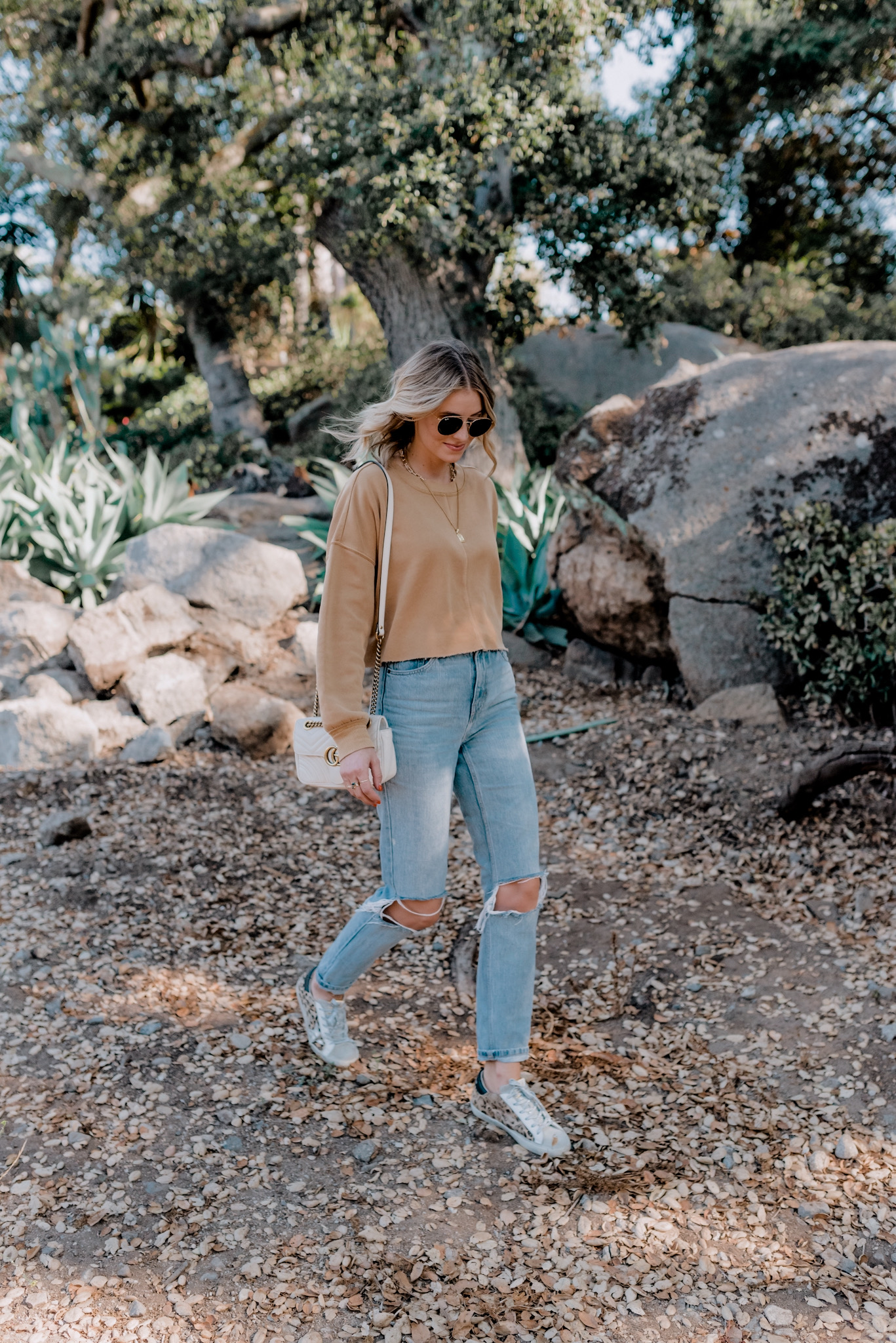 Casual Jackets by popular San Diego fashion blog, Navy Grace: image of a woman wearing a Top Shop Double Ripped Mom Jeans,GOLDEN GOOSE Beige & Brown Horsy Superstar Sneakers, JCPenney Arizona Juniors Womens Crew Neck Long Sleeve Sweatshirt,Small Matelassé Leather Shoulder Bag, and Ray-Ban 51mm Aviator Sunglasses.