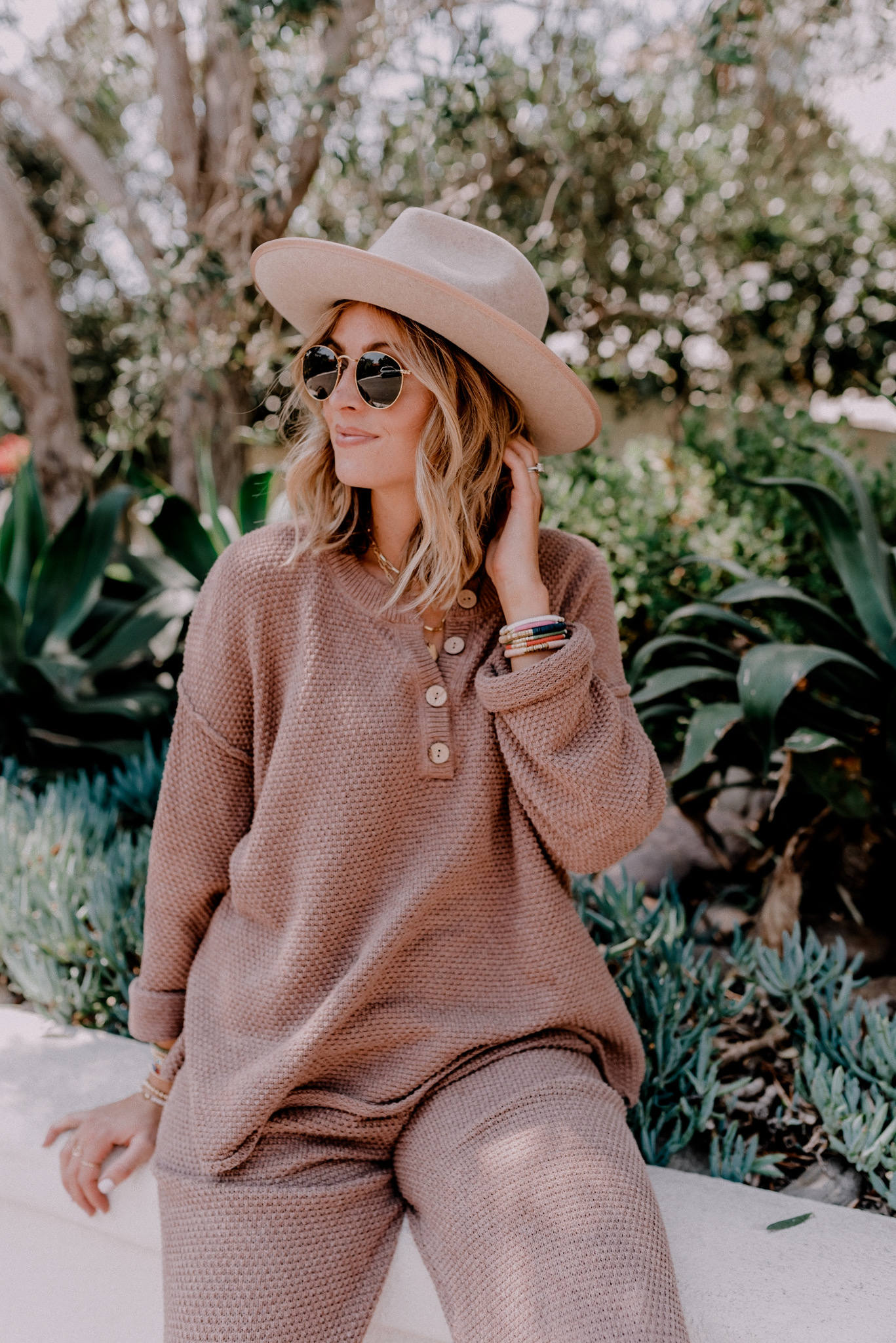 Loungewear Sets by popular San Diego fashion blog, Navy Grace: image of a woman wearing a Free People Hailee Sweater Set, Gigi Pip Monroe hat,Chuck Taylor® High Top Sneaker CONVERSE, and Ray-Ban sunglasses.