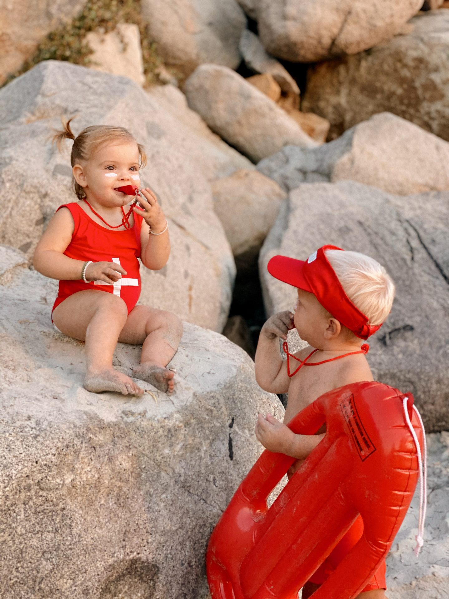 Family Halloween Costumes by popular San Diego lifestyle blog, Navy Grace: image of two young kids dressed up as lifeguards.