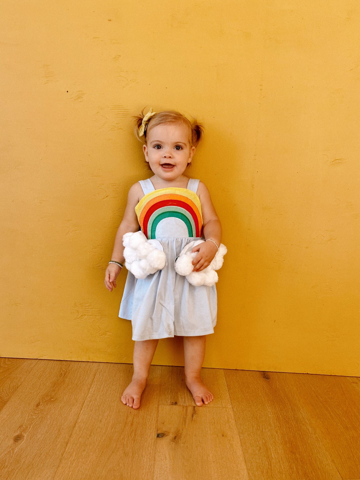 Family Halloween Costumes by popular San Diego lifestyle blog, Navy Grace: image of two young kids dressed up as a rainbow and a rain cloud.