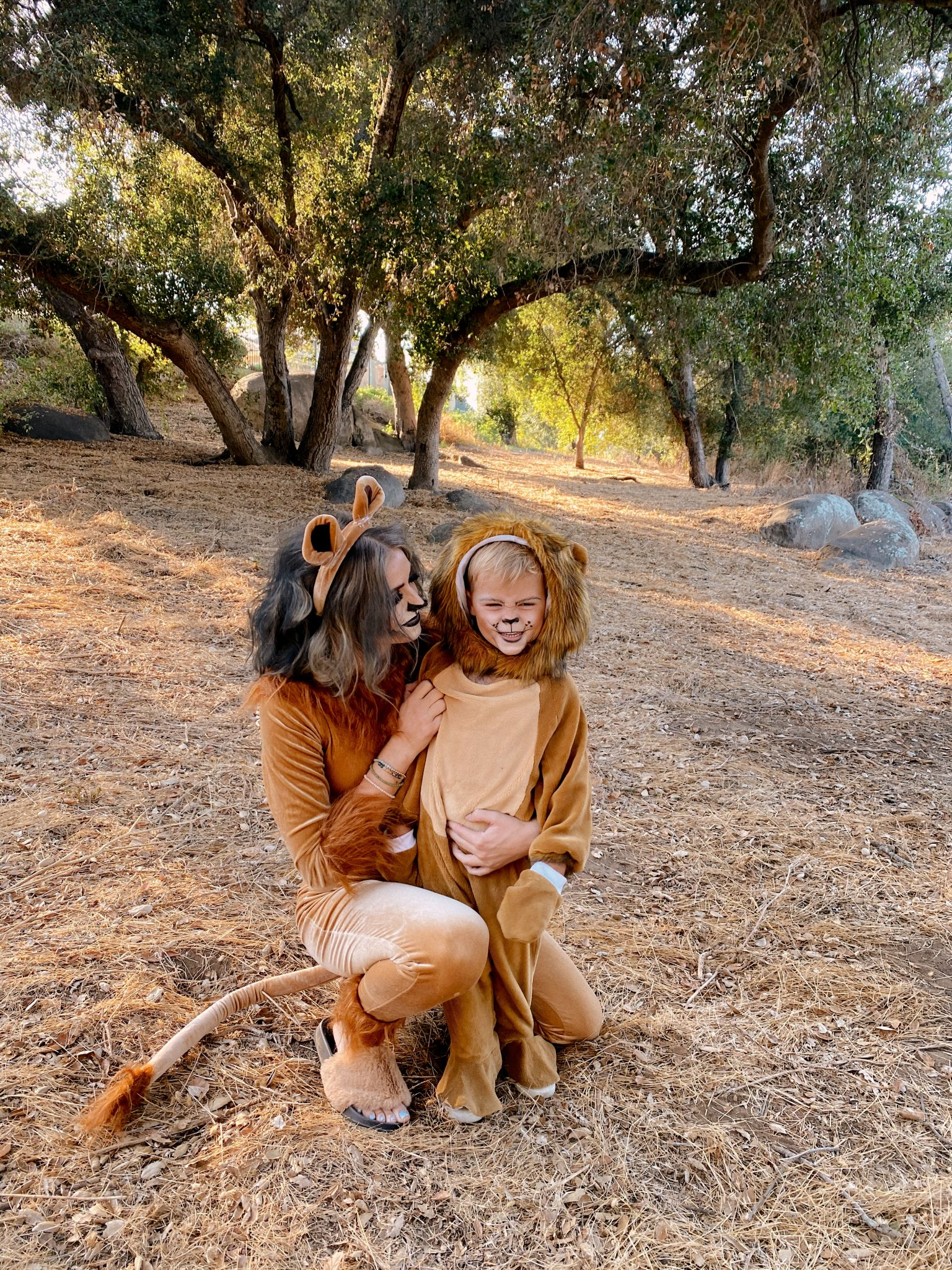 Family Halloween Costumes by popular San Diego lifestyle blog, Navy Grace: image of a mom and her son dressed up as lions.