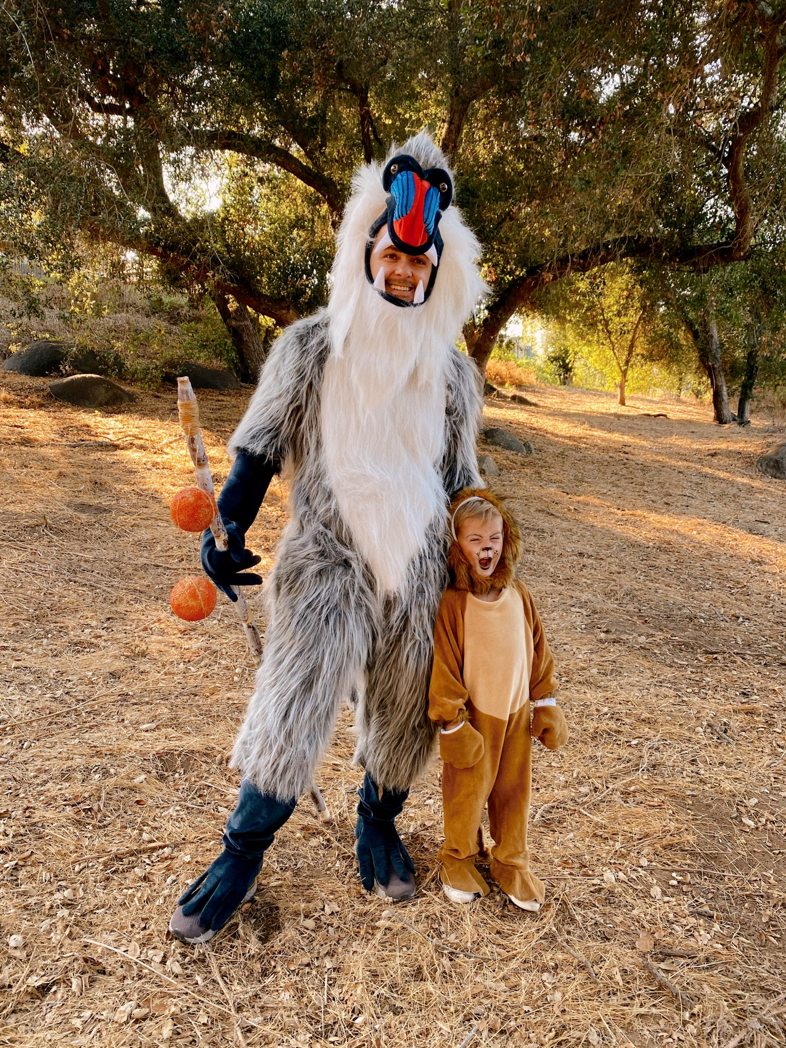 Family Halloween Costumes by popular San Diego lifestyle blog, Navy Grace: image of a dad and son dressed up as Raffiki and Simba from The Lion King.