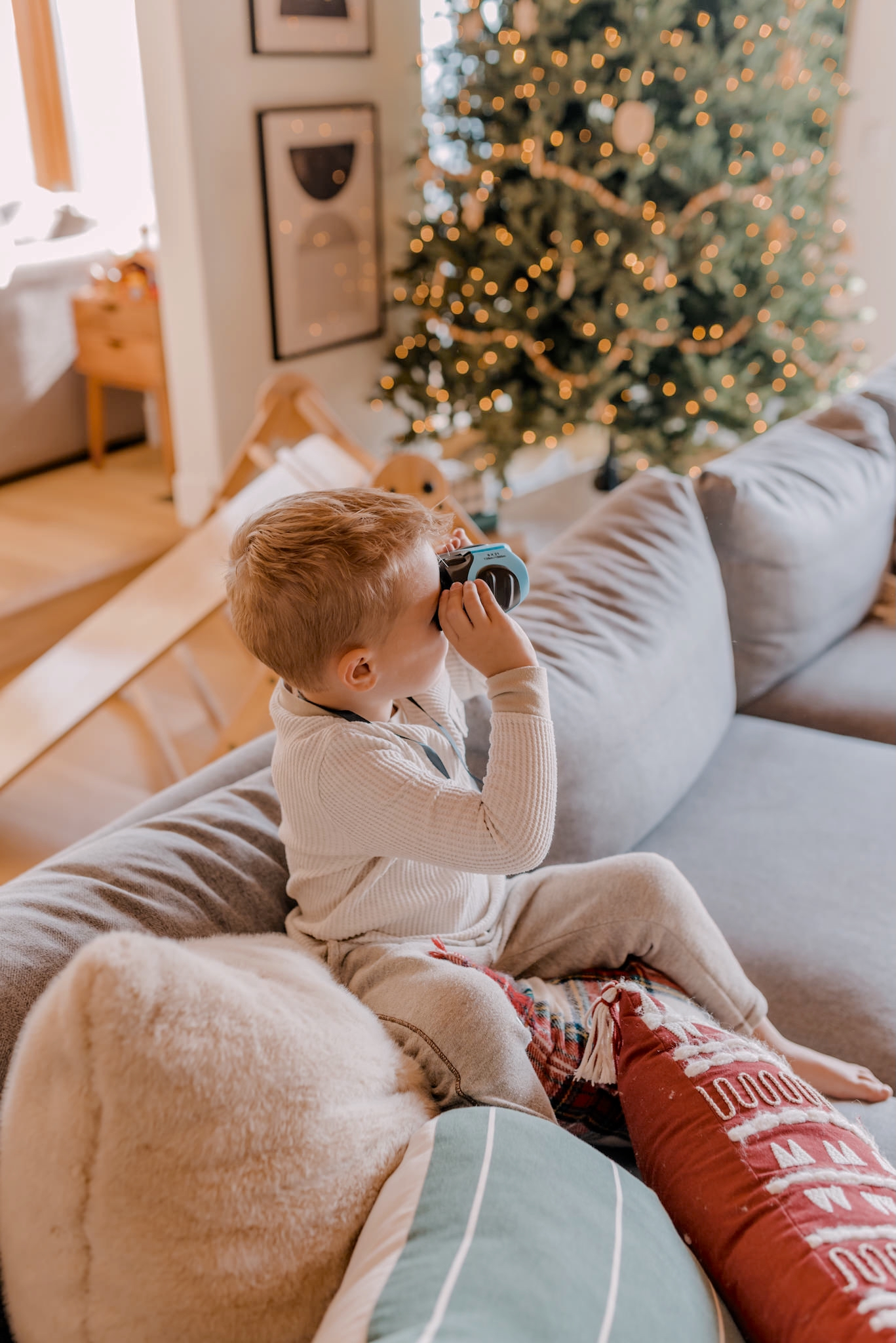 24 PRESCHOOLER GIFTS YOUR 3 TO 5 YEAR OLDS WILL LOVE featured by top San Diego lifestyle blogger, Navy Grace |Preschooler Gifts by popular San Diego lifestyle blog, Navy Grace: image of a young boy looking through binoculars.