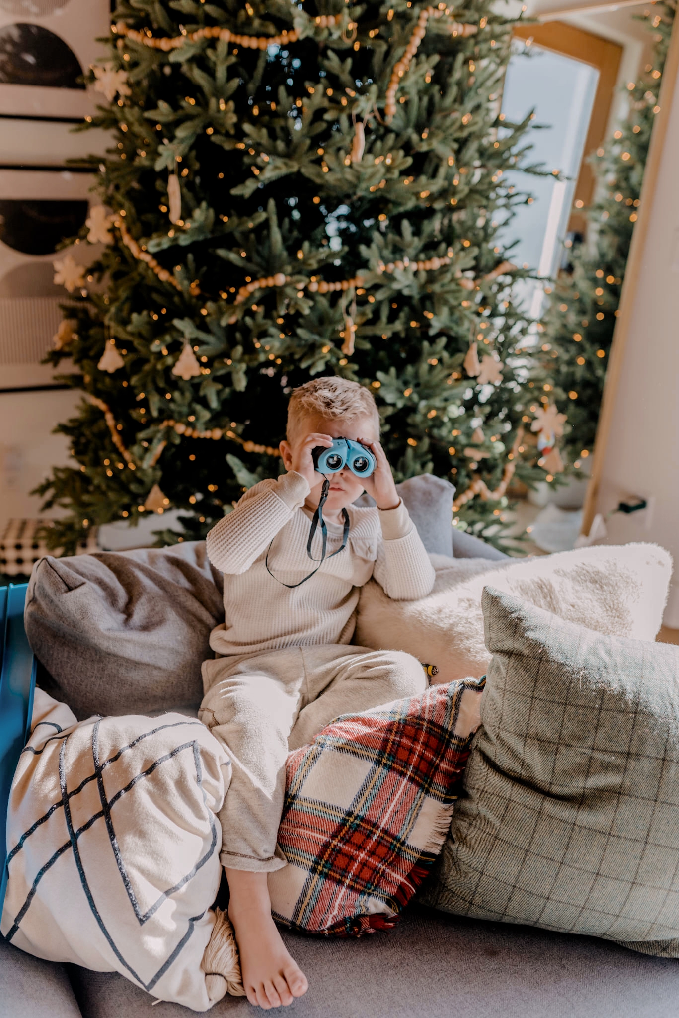 24 PRESCHOOLER GIFTS YOUR 3 TO 5 YEAR OLDS WILL LOVE featured by top San Diego lifestyle blogger, Navy Grace |Preschooler Gifts by popular San Diego lifestyle blog, Navy Grace: image of a young boy looking through some binoculars.