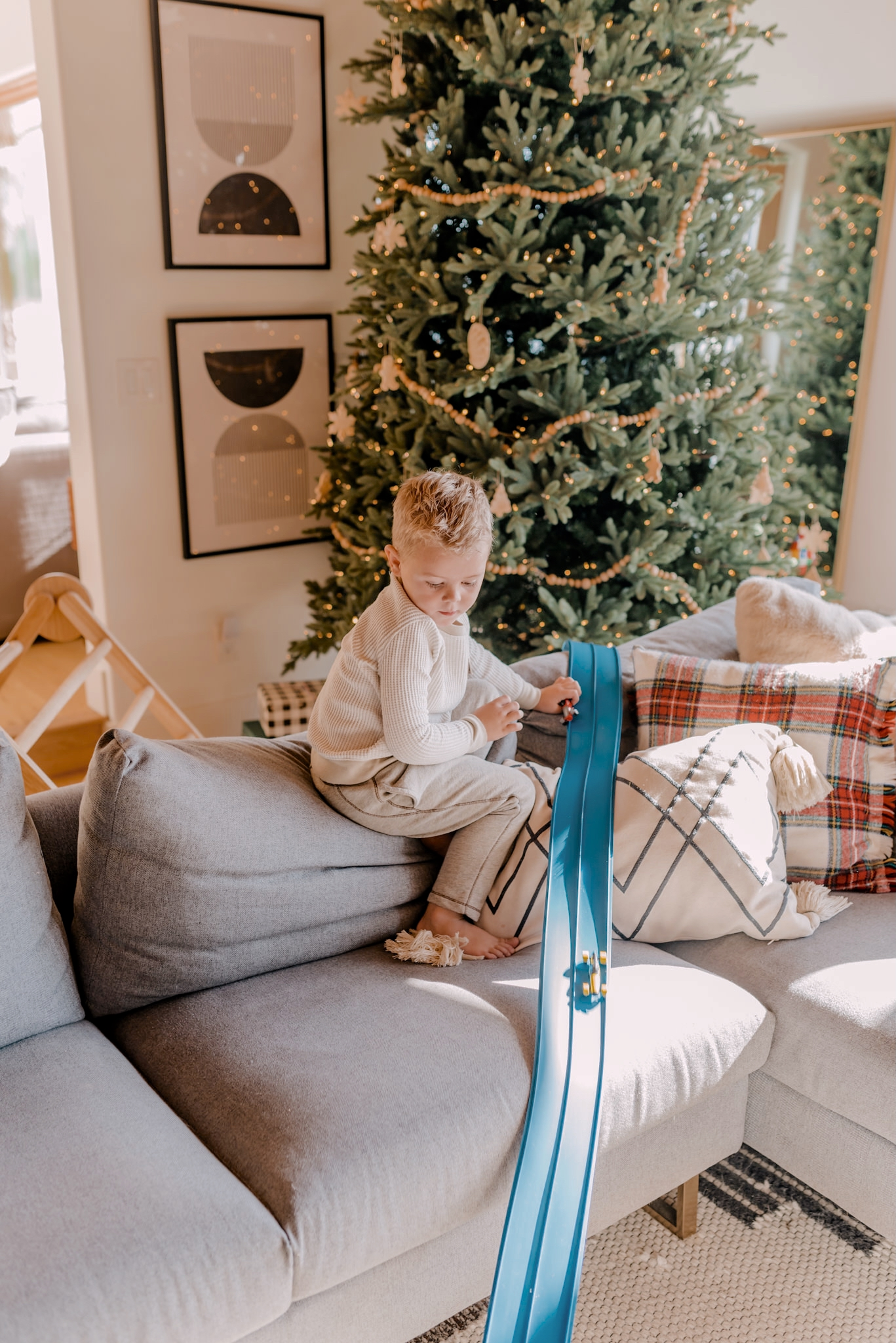 24 PRESCHOOLER GIFTS YOUR 3 TO 5 YEAR OLDS WILL LOVE featured by top San Diego lifestyle blogger, Navy Grace |Preschooler Gifts by popular San Diego lifestyle blog, Navy Grace: image of a young boy playing with cars.