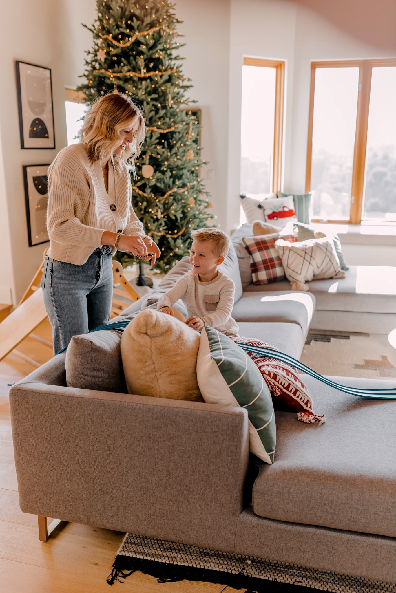 24 PRESCHOOLER GIFTS YOUR 3 TO 5 YEAR OLDS WILL LOVE featured by top San Diego lifestyle blogger, Navy Grace |Preschooler Gifts by popular San Diego lifestyle blog, Navy Grace: image of a mom and young boy playing together with cars.