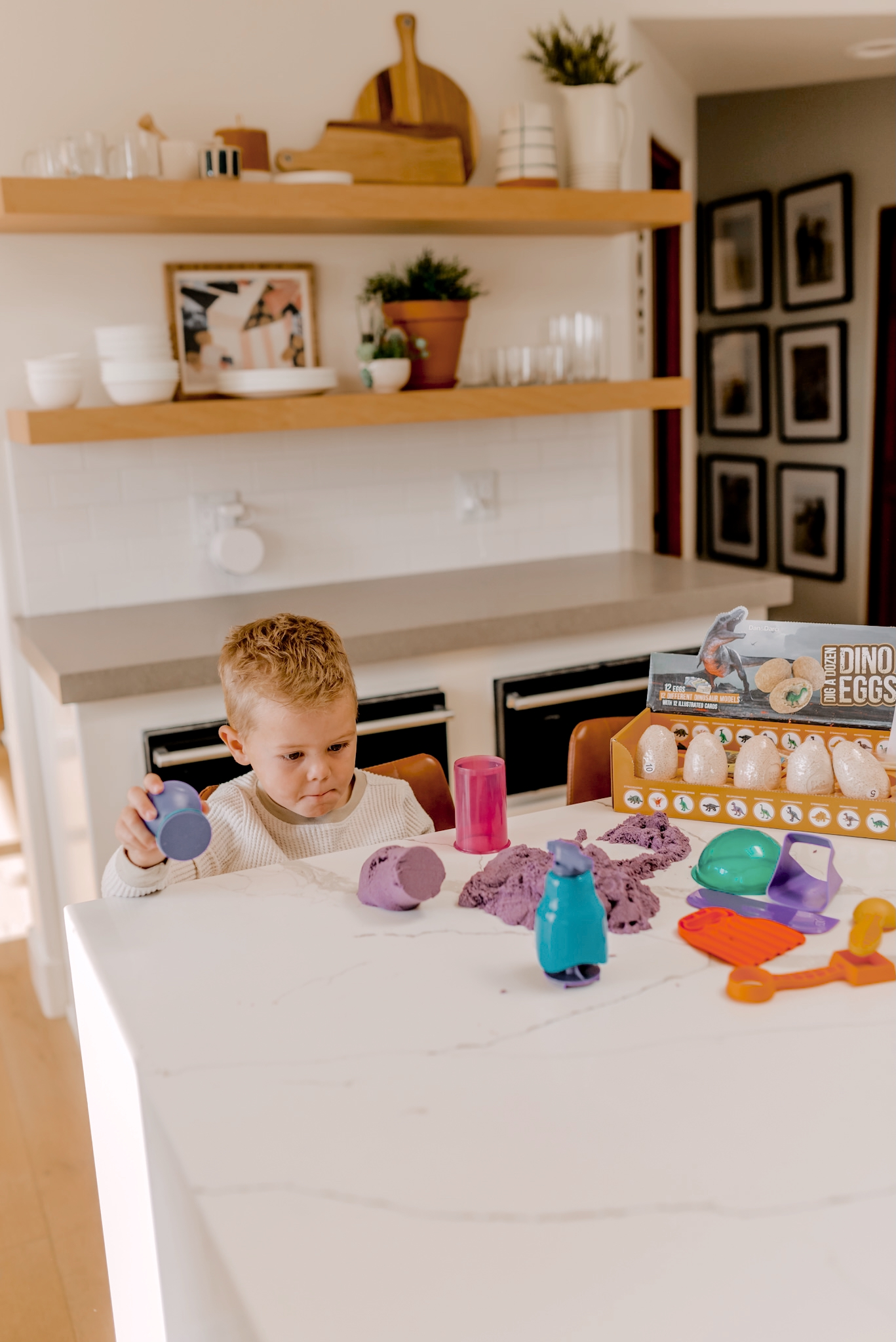 24 PRESCHOOLER GIFTS YOUR 3 TO 5 YEAR OLDS WILL LOVE featured by top San Diego lifestyle blogger, Navy Grace |Preschooler Gifts by popular San Diego lifestyle blog, Navy Grace: image of a young boy playing with kinetic sand.