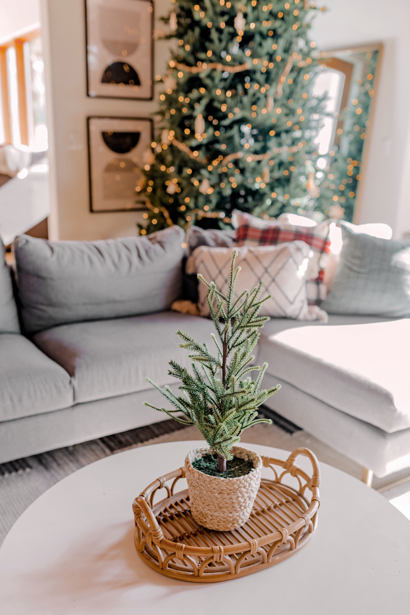 Holiday Gift Guide for the Home  Gifts for the Home by popular San Diego life and style blog, Navy Grace: image of a faux mini pine tree in a woven grass pot that's resting on a rattan serving tray.