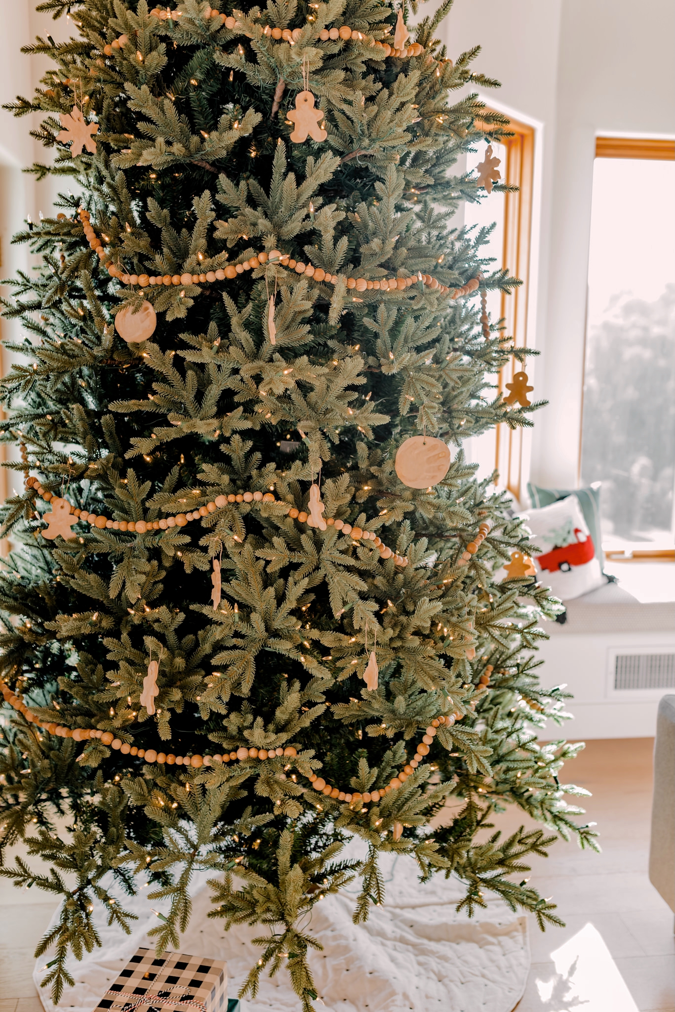 Holiday Gift Guide for the Home  Gifts for the Home by popular San Diego life and style blog, Navy Grace: image of a Christmas tree decorated with salt dough ornaments and a wooden bead garland.