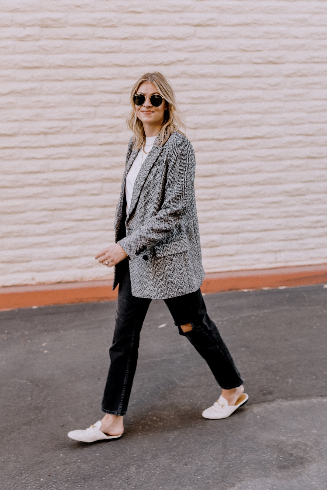 Blazers for Women by popular San Diego fashion blog, Navy Grace: image of a woman wearing a H&M Double-breasted Jacket, Nordstorm TopShop Chicago Ripped Knee High Waist Dad Jeans, Everlane The Air Oversized Crew Tee, Nordstrom Gucci Princetown Loafer Mule, Nordstrom Gucci Matelassé Leather Shoulder Bag, and Nordstrom Ray-Ban Icons 53mm Retro Sunglasses.