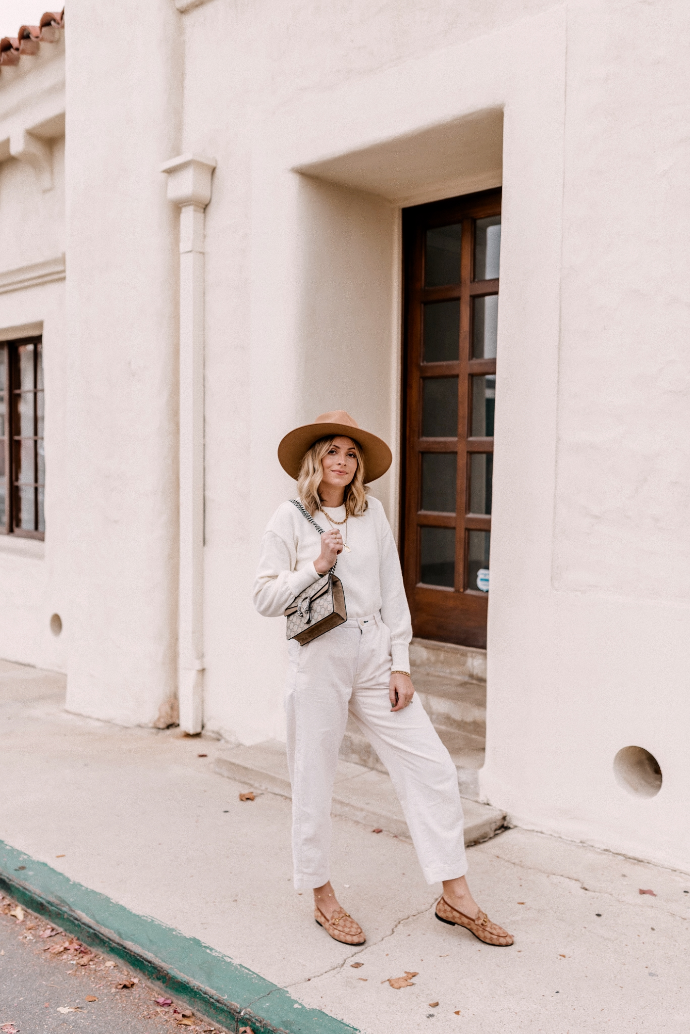 Fall fedora Hats |Fall fedora Hats |Fall fedora Hats | Fedora Hats by popular San Diego fashion blog, Navy Grace: image of a woman wearing a Madewell Brushed Knit Puff-Sleeve Top, Everlane The Arc Canvas Pant,Gucci Women's Jordaan GG Canvas Loafers and Free People Rancher Felt Hat.