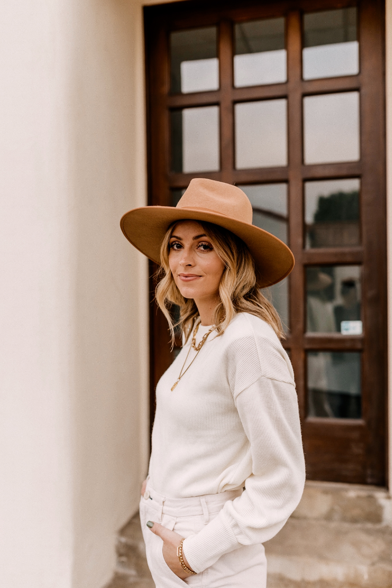 Fall fedora Hats |Fedora Hats by popular San Diego fashion blog, Navy Grace: image of a woman wearing a Madewell Brushed Knit Puff-Sleeve Top, Everlane The Arc Canvas Pant,Gucci Women's Jordaan GG Canvas Loafers and Free People Rancher Felt Hat.