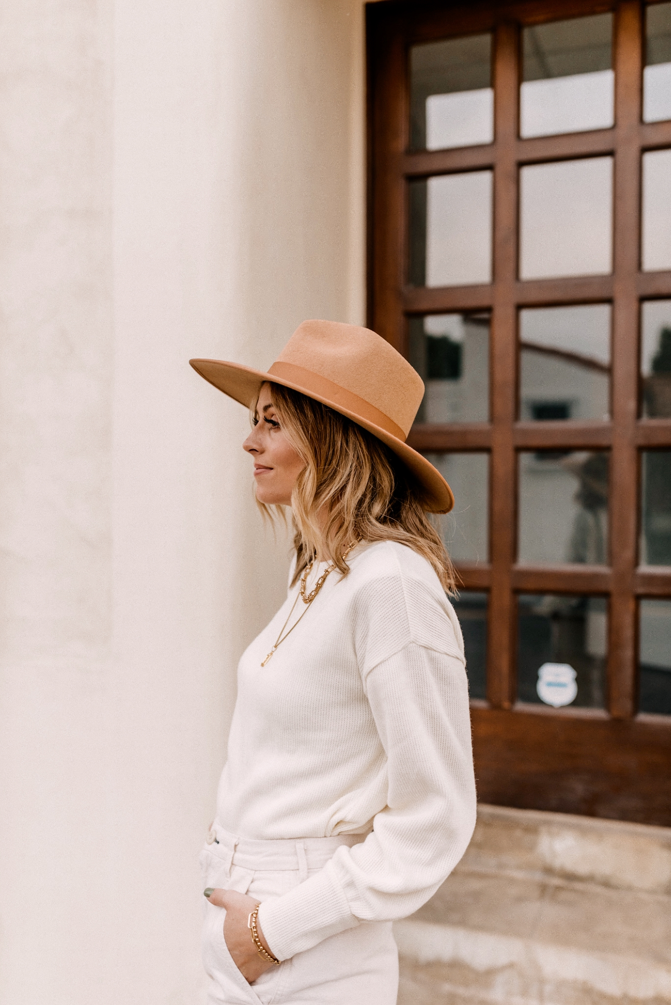 Fall fedora Hats |Fall fedora Hats | Fedora Hats by popular San Diego fashion blog, Navy Grace: image of a woman wearing a Madewell Brushed Knit Puff-Sleeve Top, Everlane The Arc Canvas Pant,Gucci Women's Jordaan GG Canvas Loafers and Free People Rancher Felt Hat.