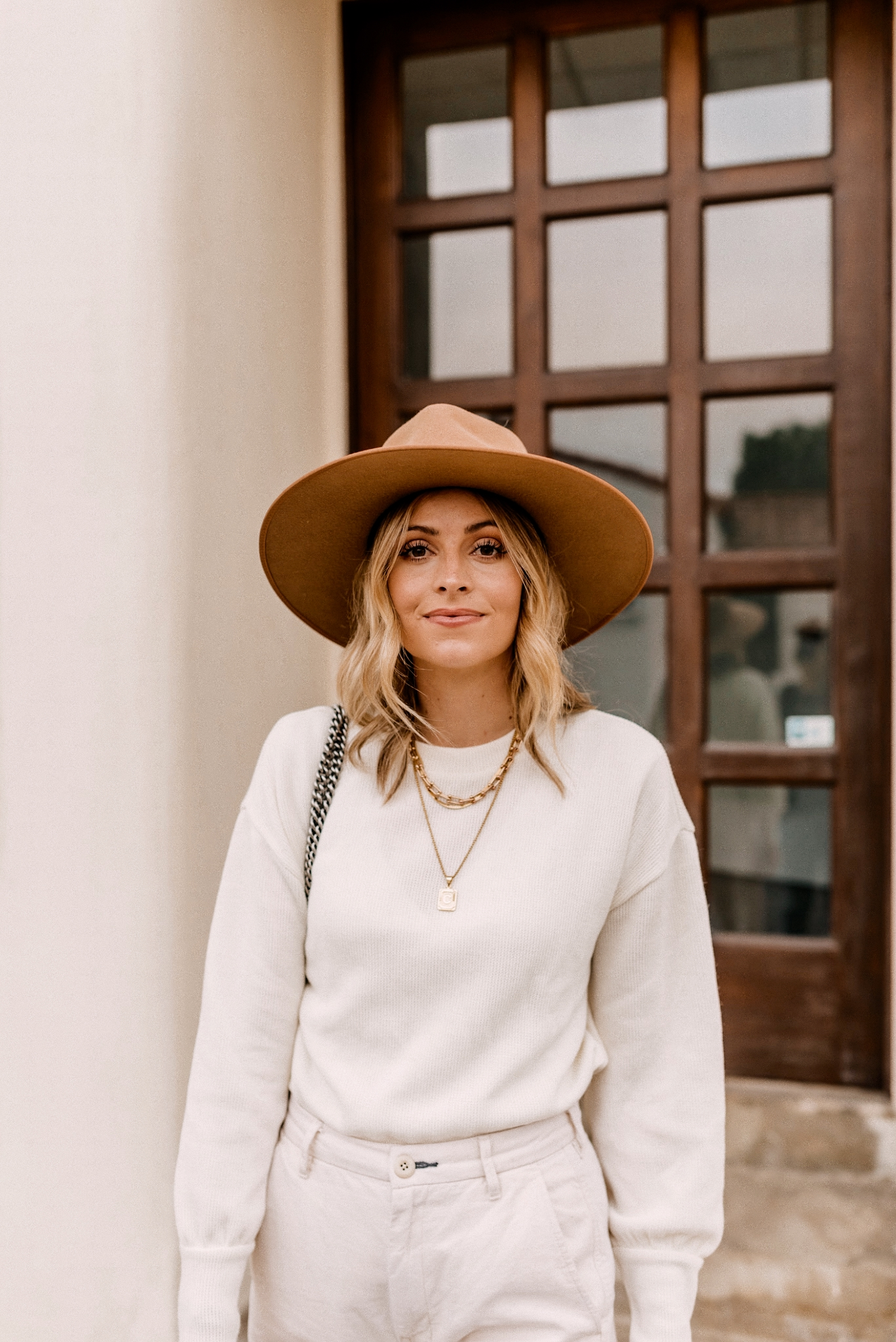 Fall fedora Hats | Fedora Hats by popular San Diego fashion blog, Navy Grace: image of a woman wearing a Madewell Brushed Knit Puff-Sleeve Top, Everlane The Arc Canvas Pant,Gucci Women's Jordaan GG Canvas Loafers and Free People Rancher Felt Hat.