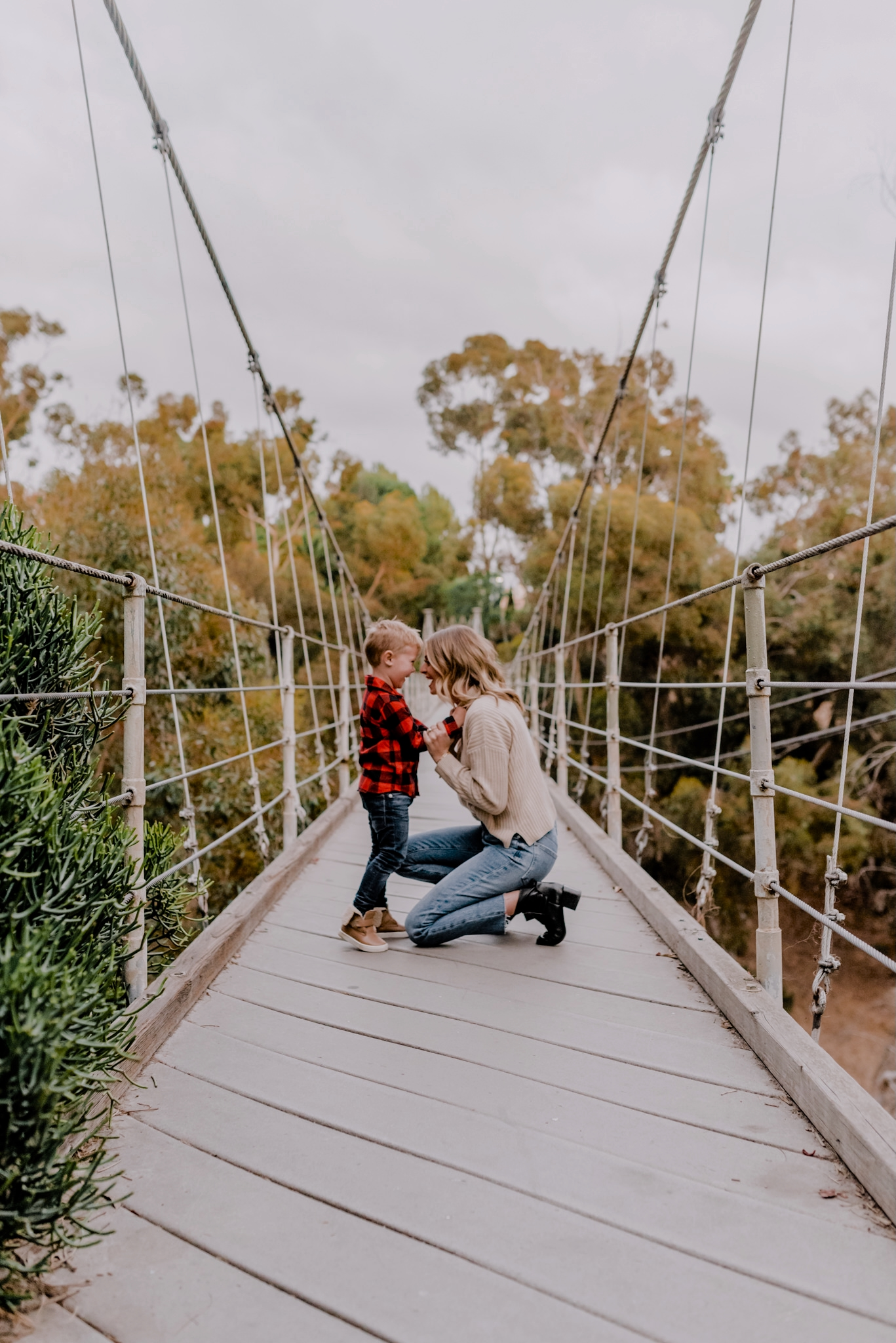 Amazon Finds by popular San Diego life and style blog, Navy Grace: image of a mom and her young son standing together on a suspension bridge.